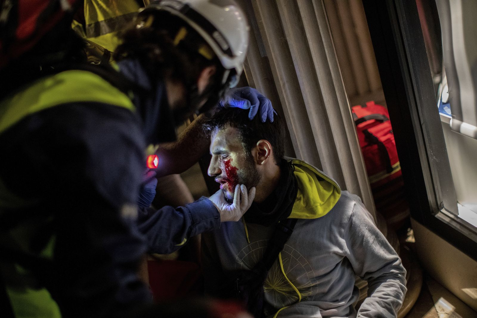 Paramedics attend a protestor during clashes with police in Barcelona, Spain, early Friday, Oct. 18, 2019.{ } (AP Photo/Bernat Armangue)