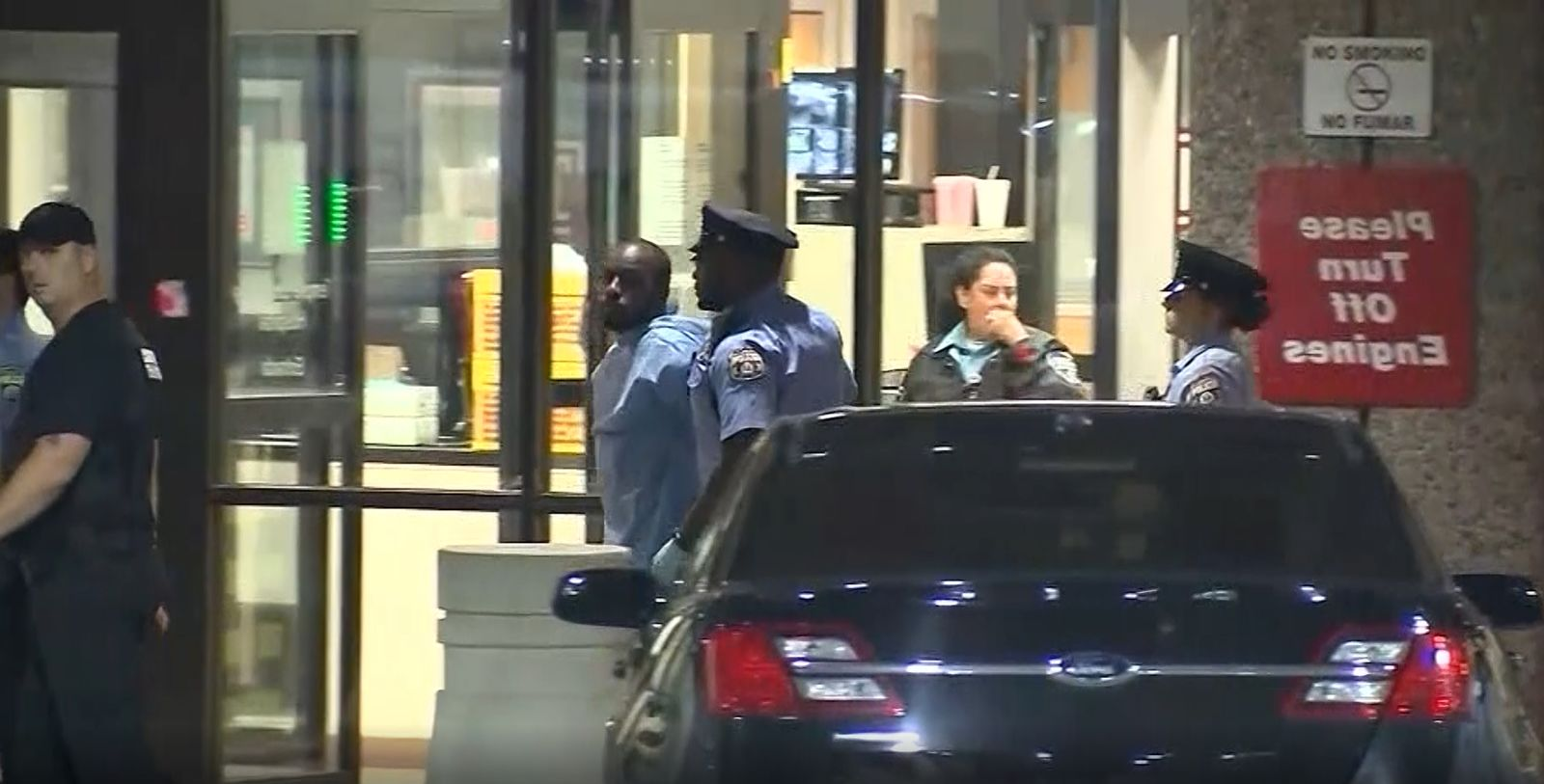 Suspect Maurice Hill in police custody after an 8-hour standoff in Philadelphia. (KYW/CNN Newsource)