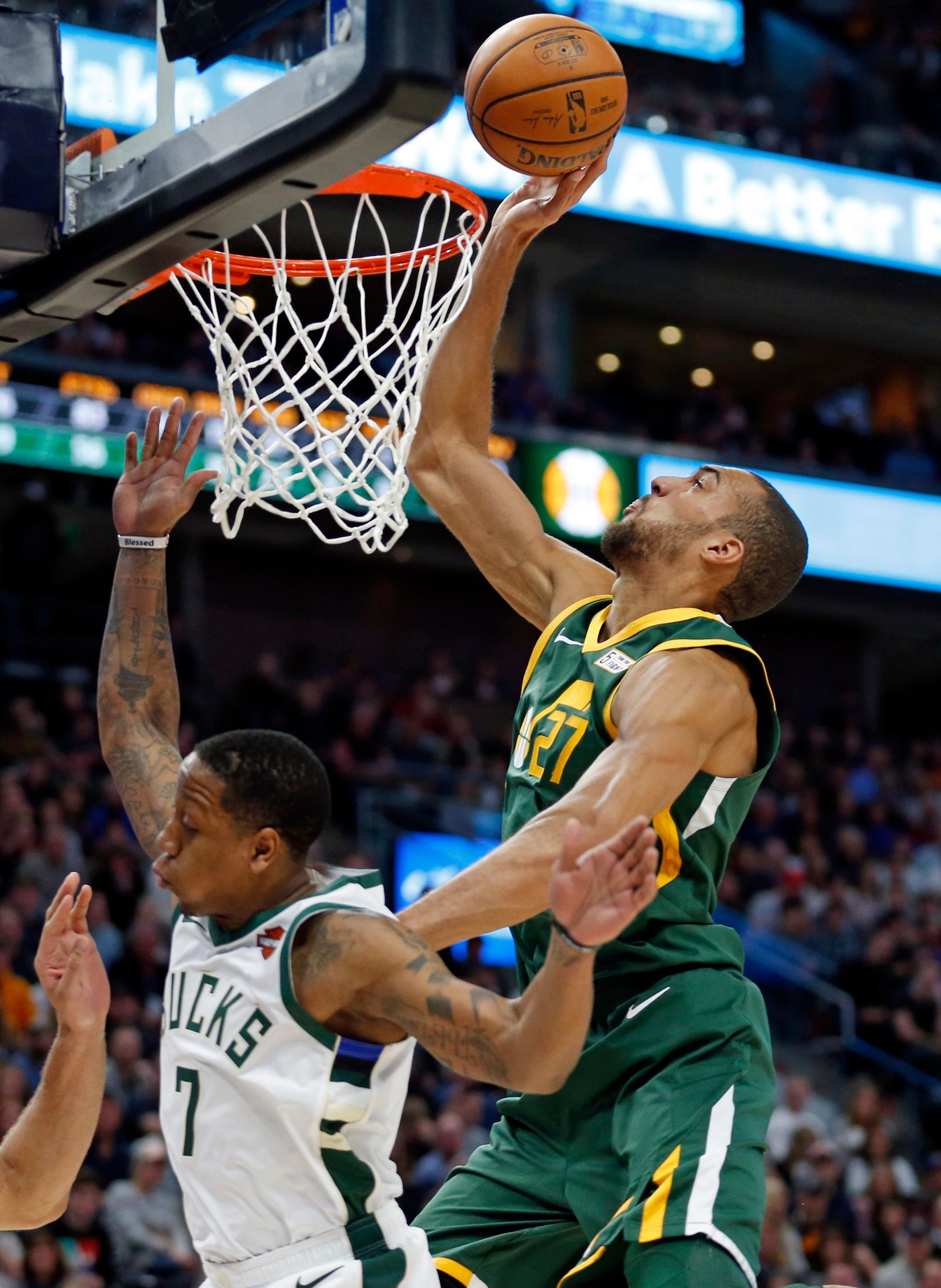 Utah Jazz center Rudy Gobert, right, tips the ball as Milwaukee Bucks guard Isaiah Canaan (7) defends during the first half of an NBA basketball game Saturday, March 2, 2019, in Salt Lake City. (AP Photo/Rick Bowmer)