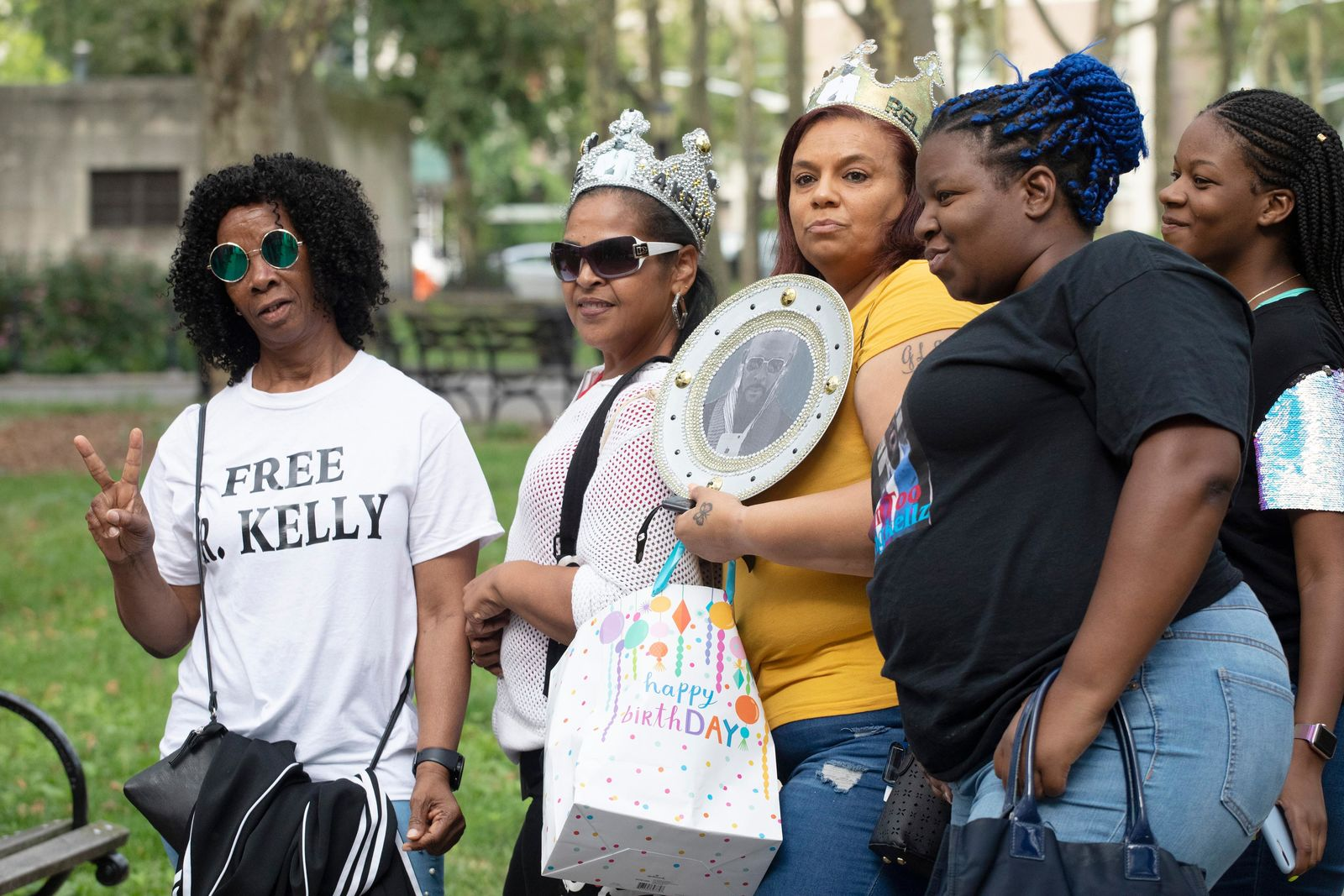 Supporters of R&B performer R. Kelly arrive at federal court in Brooklyn for his hearing, Friday, Aug. 2, 2019, in New York. Kelly faces an arraignment on charges he sexually abused women and girls. (AP Photo/Mark Lennihan)