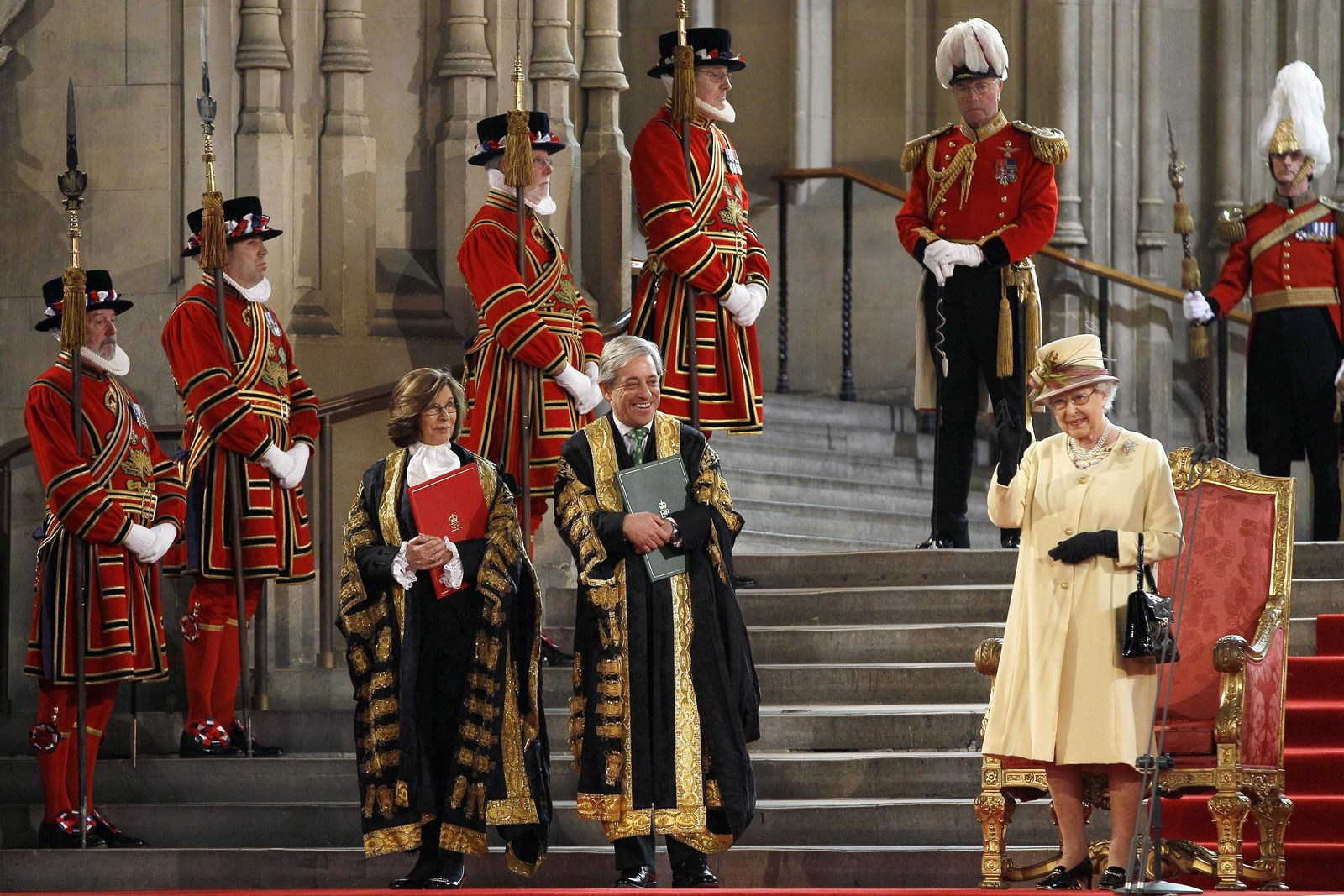 FILE - In this Tuesday, March 20, 2012 file photo, Britain's Queen Elizabeth II, right, waves after she makes an address next to Speaker of The House of lords, Baroness D'Souza, foreground left, and Speaker of The House of Commons John Bercow, foreground centre, at Westminster Hall in London. A colorful era in British parliamentary history is coming to a close with Speaker of the House John Bercow's abrupt announcement Monday, Sept. 9, 2019 that he will leave his influential post by the end of October. (AP Photo/Kirsty Wigglesworth, Pool)