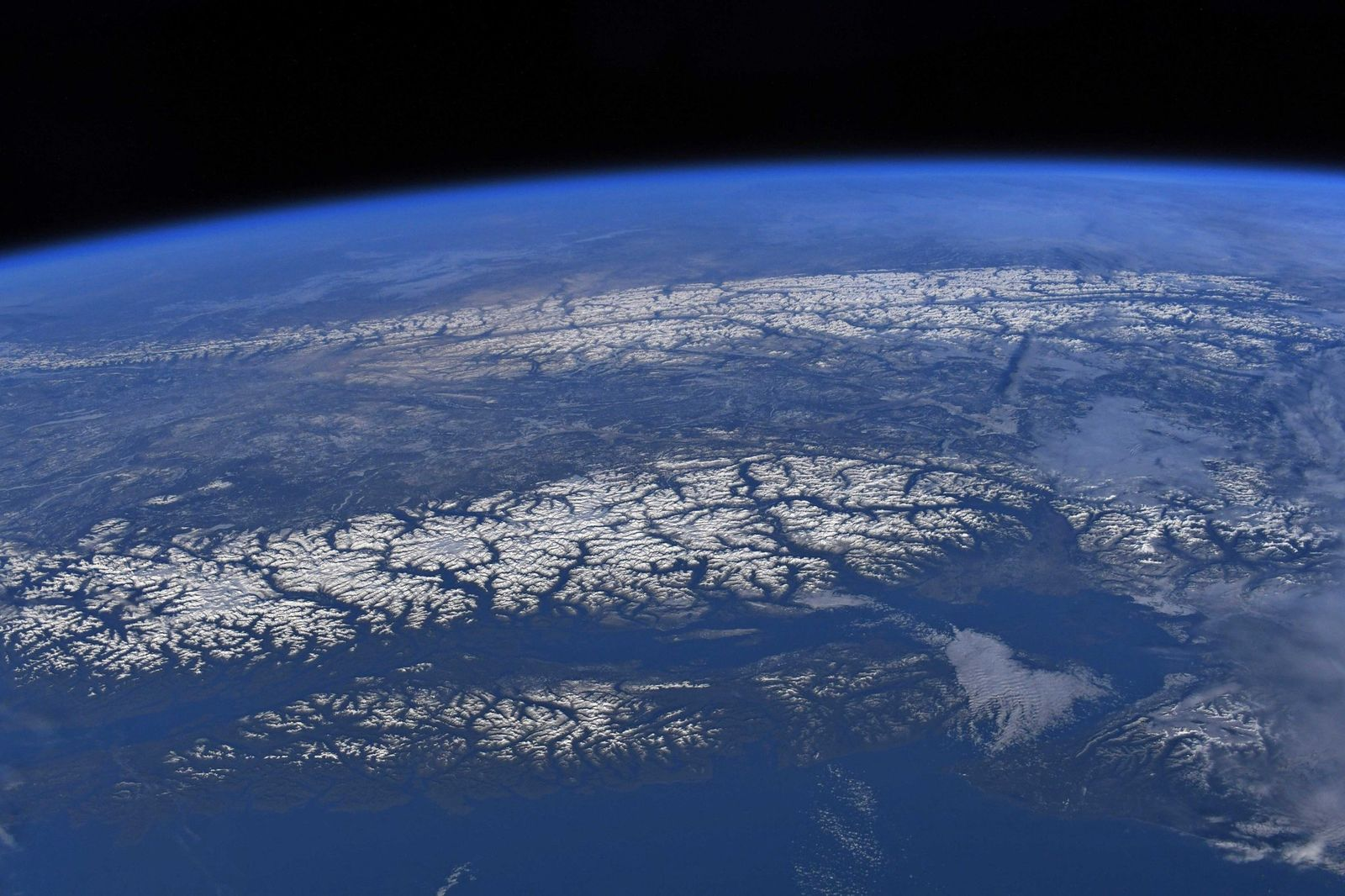 Vancouver?s snowcapped mountains resplendent in the light of dusk.  (Photo & Caption David Saint-Jacques, NASA)