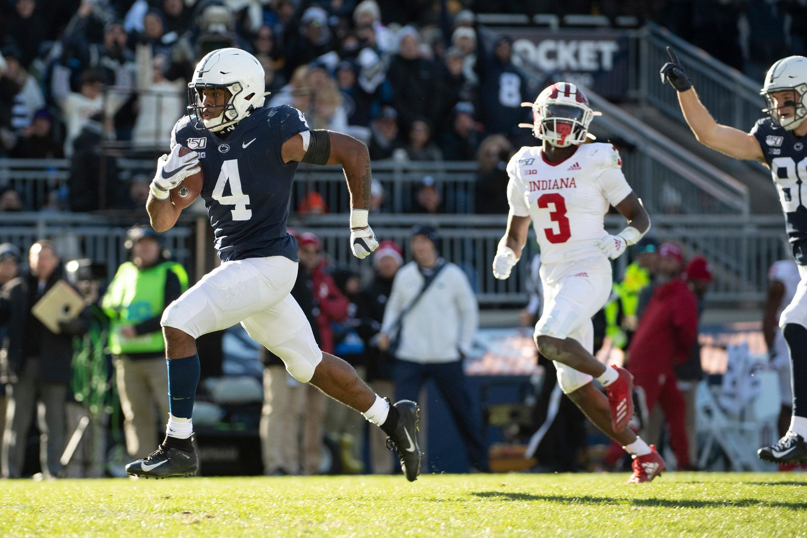 Penn State running back Journey Brown (4) eludes Indiana defensive back Tiawan Mullen (3) on his way to score a 35-yard touchdown in the third quarter of an NCAA college football game in State College, Pa., on Saturday, Nov.16, 2019. Penn State defeated 34-27. (AP Photo/Barry Reeger)