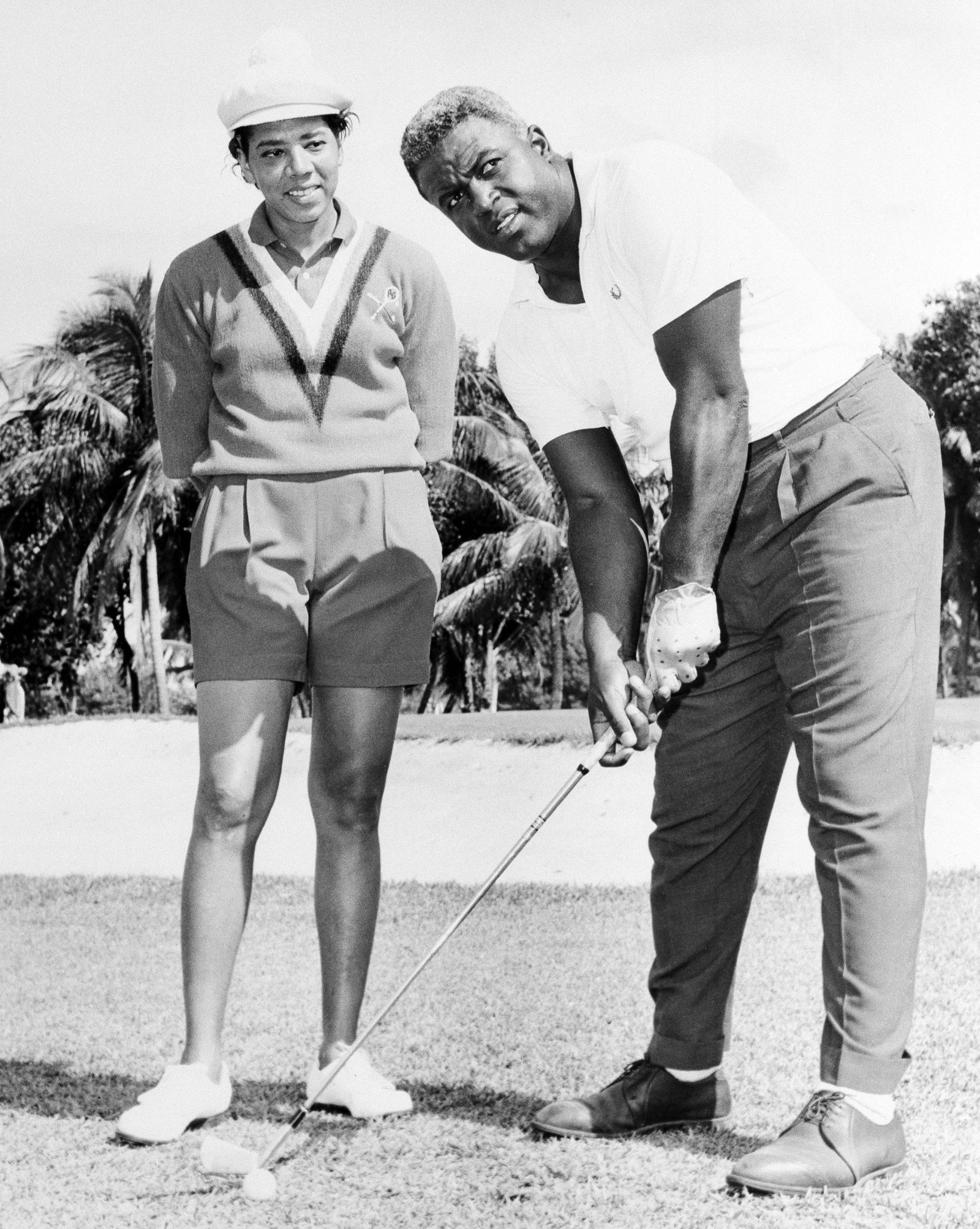"FILE - In this Feb. 23, 1962 file photo shows  Althea Gibson, former amateur tennis champion, and Jackie Robinson at the North-South Tournament at the Miami Springs course. When the US Open begins this week, she will have a statue unveiled in her honor. Says tennis great Billie Jean King: ""She's our Jackie Robinson of tennis."" (AP Photo)"
