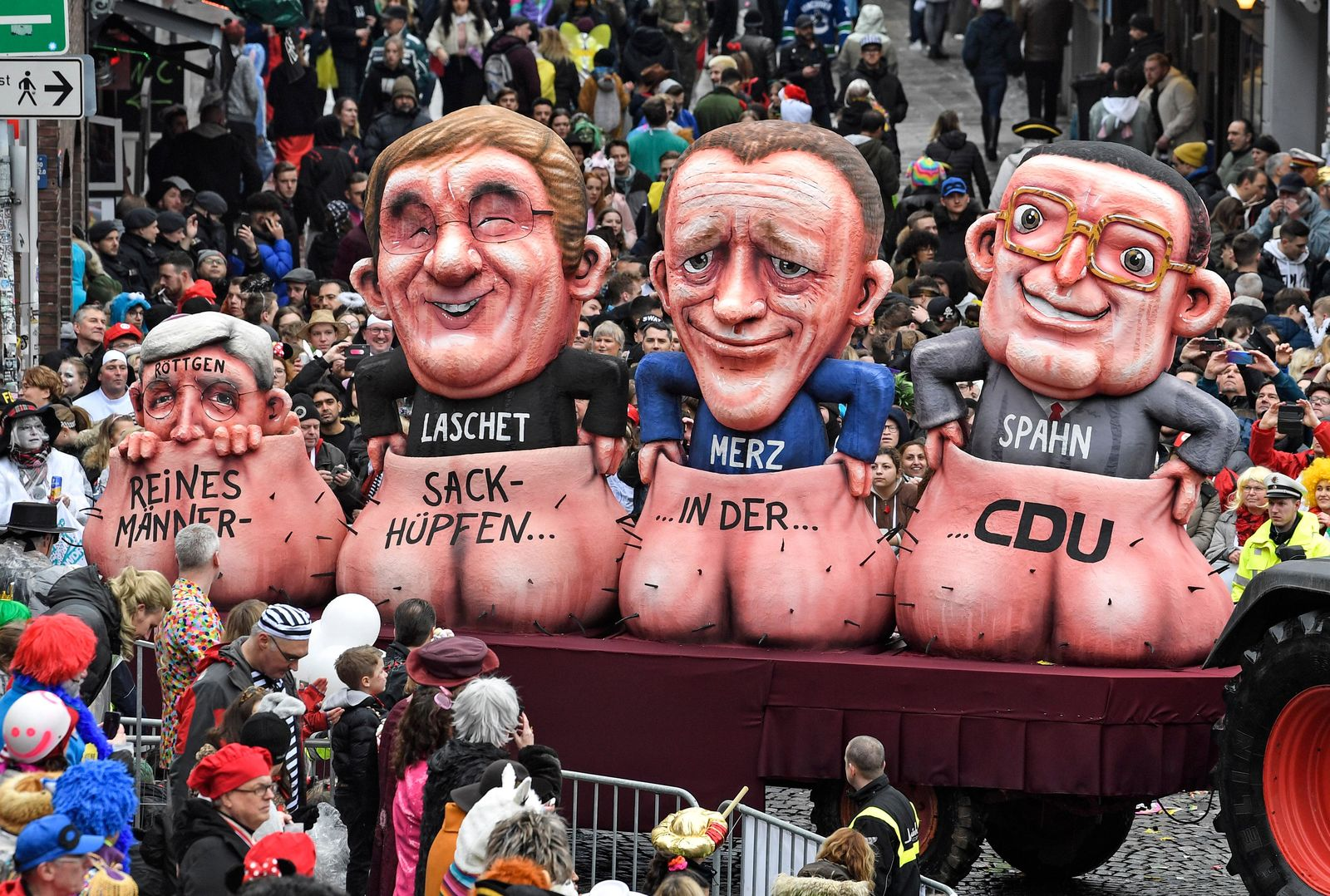 A carnival float depicts the candidates for the chairman of Merkel's Christian Democratic Union, CDU, during the traditional carnival parade in Duesseldorf, Germany, on Monday, Feb. 24, 2020. The foolish street spectacles in the carnival centers of Duesseldorf, Mainz and Cologne, watched by hundreds of thousands of people, are the highlights in Germany's carnival season on Rosemonday. (AP Photo/Martin Meissner)
