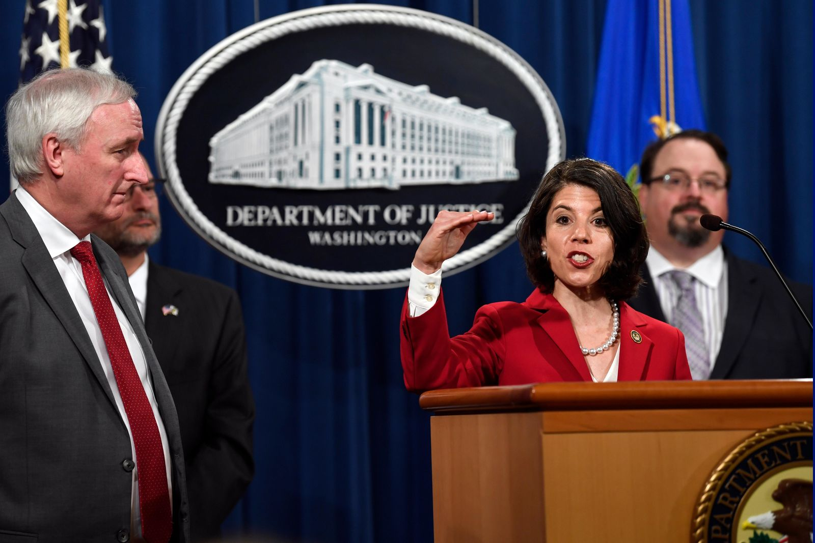 Associate Deputy Attorney General Toni Bacon, second from right, speaks during a news conference at the Justice Department in Washington, Friday, July 19, 2019, on developments in the implementation of the First Step Act. (AP Photo/Susan Walsh)