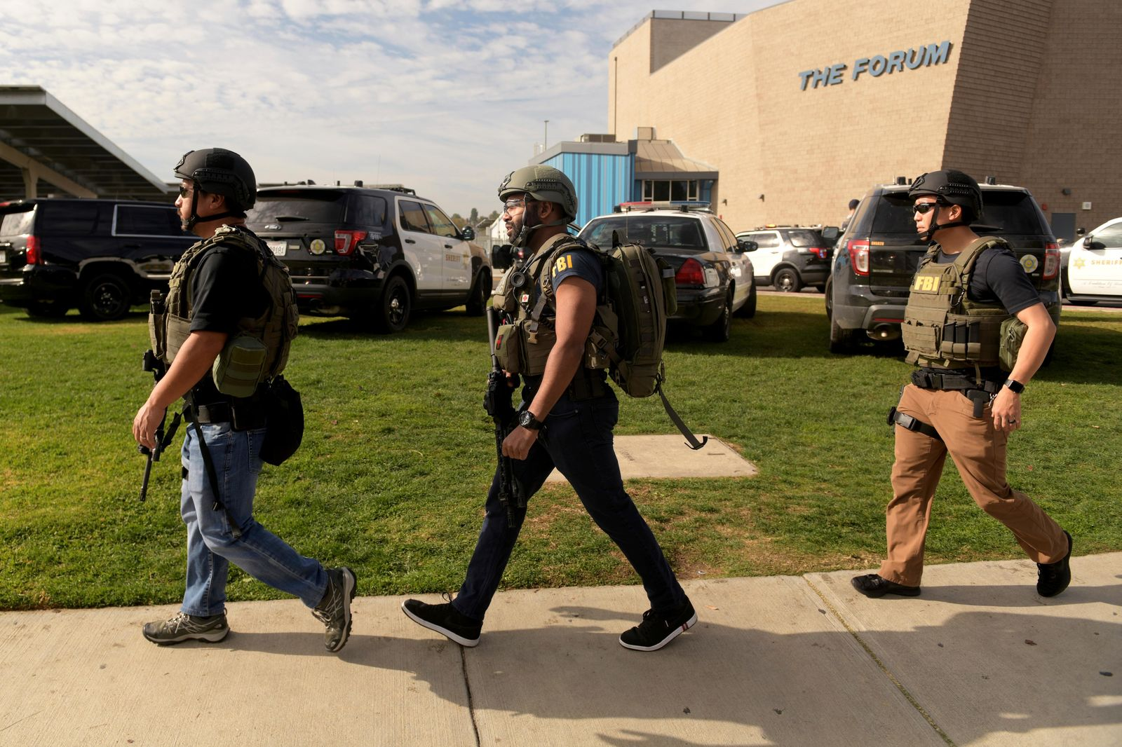 Heavily armed FBI officials survey the scene after a gunman opened fire at Saugus High School on Thursday, Nov. 14, 2019, in Santa Clarita, Calif. (AP Photo/Christian Monterrosa)