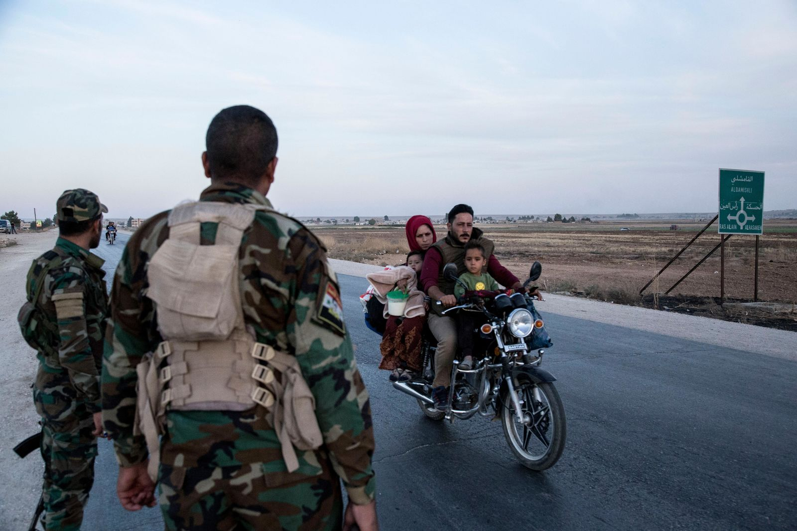 Syrian government troops man a checkpoint town of Tal Tamr in northeast Syria, Monday, Oct. 14, 2019. (AP Photo/Baderkhan Ahmad)