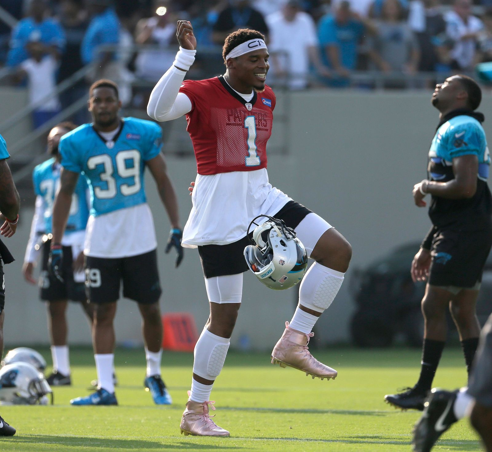Carolina Panthers' Cam Newton (1) dances as players warm up during practice at training camp at Wofford College in Spartanburg, S.C., Wednesday, July 26, 2017. (AP Photo/Chuck Burton)