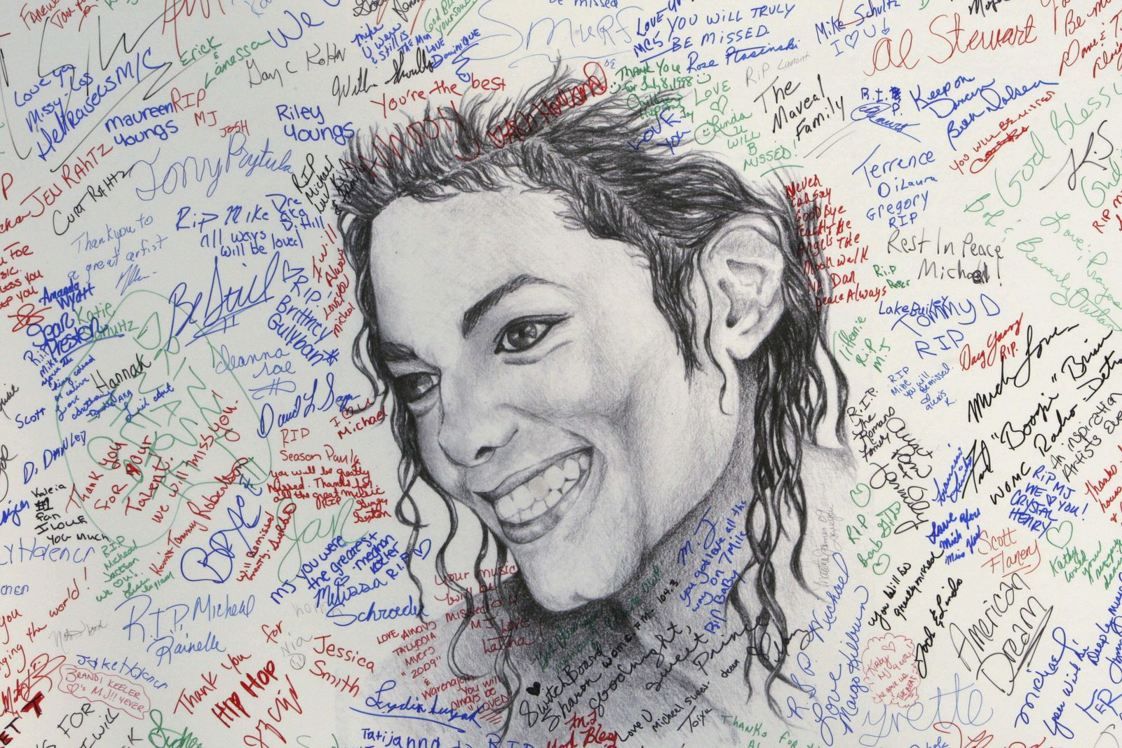 FILE - This July 7, 2009 file photo shows signatures on a poster of the late pop icon Michael Jackson at the Charles H. Wright Museum of African American History in Detroit. Tuesday, June 25, 2019, marks the tenth anniversary of Jackson's death. (AP Photo/Carlos Osorio, File)
