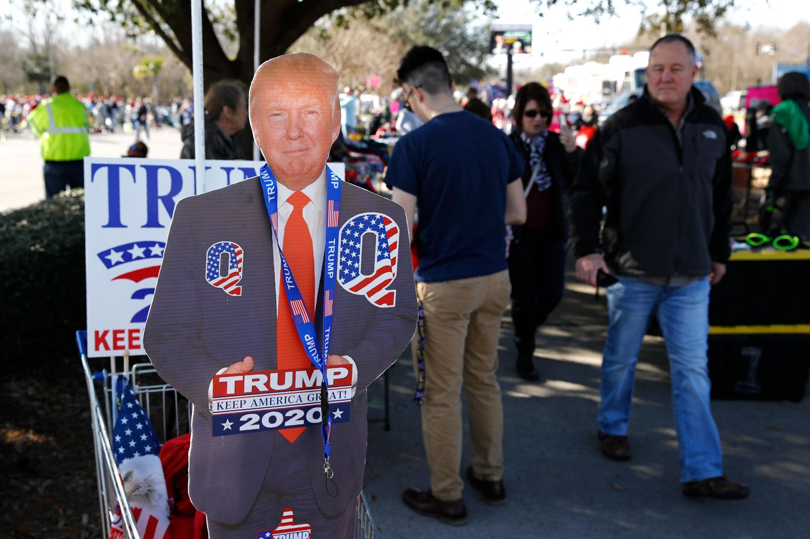Attendees gather outside a campaign rally for President Donald Trump, Friday, Feb. 28, 2020, in North Charleston, S.C. (AP Photo/Patrick Semansky)