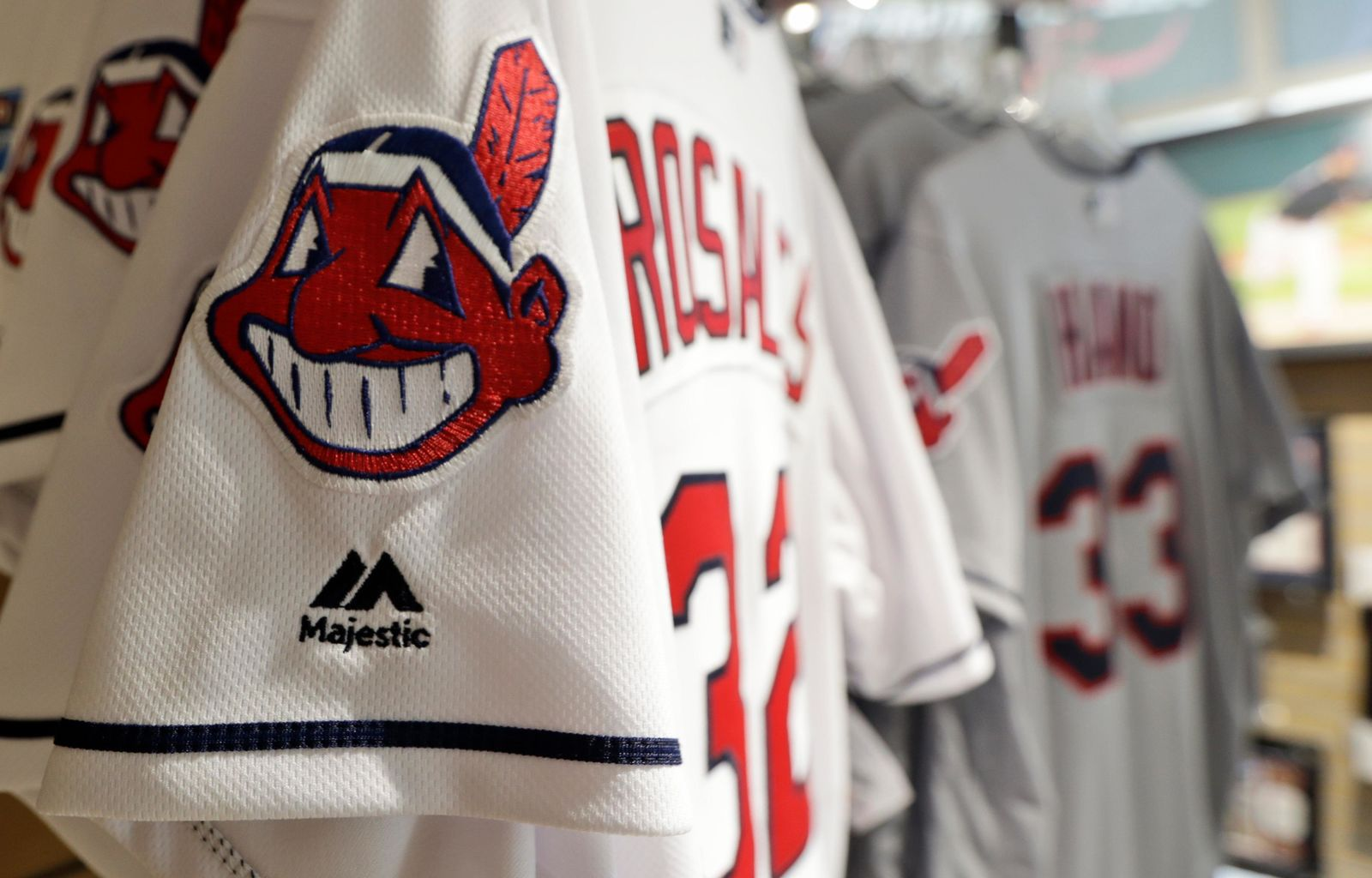 Jersey's with Chief Wahoo are displayed in the team shop, Wednesday, July 3, 2019, in Cleveland. While Major League Baseball and the Indians mutually agreed in 2018 to completely remove him from the team's jerseys and caps as well as banners and signage in the ballpark starting this season, when Cleveland hosts the All-Star Game for the sixth time, the red-faced, toothy caricature remains omnipresent across town.(AP Photo/Tony Dejak)