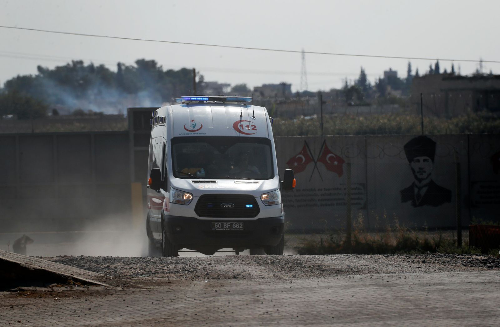An ambulance returns from Tal Abyad, Syria, at the border in the town of Akcakale,  Sanliurfa province, southeastern Turkey, Monday, Oct. 21, 2019. Turkey's President Recep Tayyip Erdogan is scheduled to meet Tuesday with Russian leader Vladimir Putin and the conflict between Turkey and the Kurds is expected to be the focus of their discussions. (AP Photo/Lefteris Pitarakis)