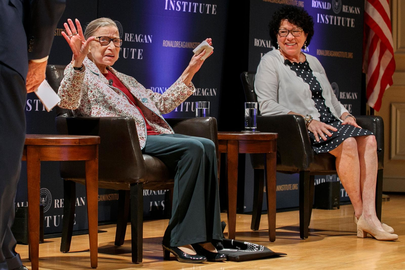 FILE - In this Sept. 25, 2019 file photo, Supreme Court Justice Ruth Bader Ginsburg, left, holds up her hands as she and Supreme Court Justice Sonia Sotomayor arrive to applause for a panel discussion celebrating Sandra Day O'Connor, the first woman to be a Supreme Court Justice, at the Library of Congress in Washington. (AP Photo/Jacquelyn Martin)