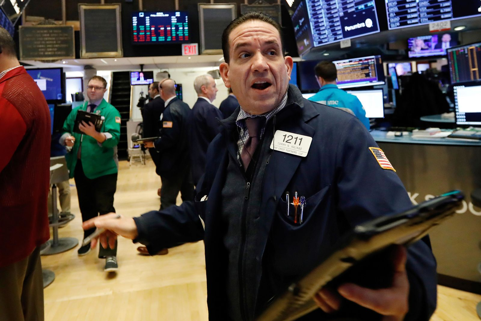 Trader Tommy Kalikas works on the floor of the New York Stock Exchange, Friday, Jan. 11, 2019. (AP Photo/Richard Drew)