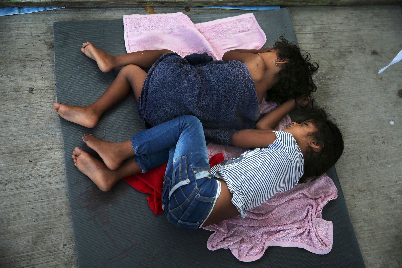 FILE - In this July 17, 2019, file photo, migrant children sleep on a mattress on the floor of the AMAR migrant shelter in Nuevo Laredo, Mexico. (AP Photo/Marco Ugarte, File)