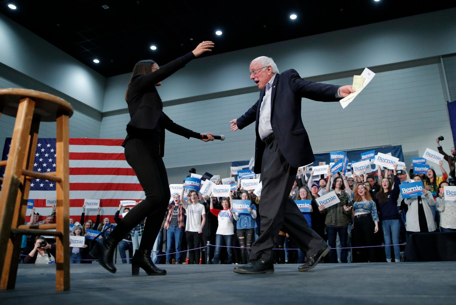 Democratic presidential candidate Sen. Bernie Sanders, I-Vt., right, embraces Rep. Alexandria Ocasio-Cortez, D-NY, at a campaign rally Sunday, Jan. 26, 2020, in Sioux City, Iowa. (AP Photo/John Locher)