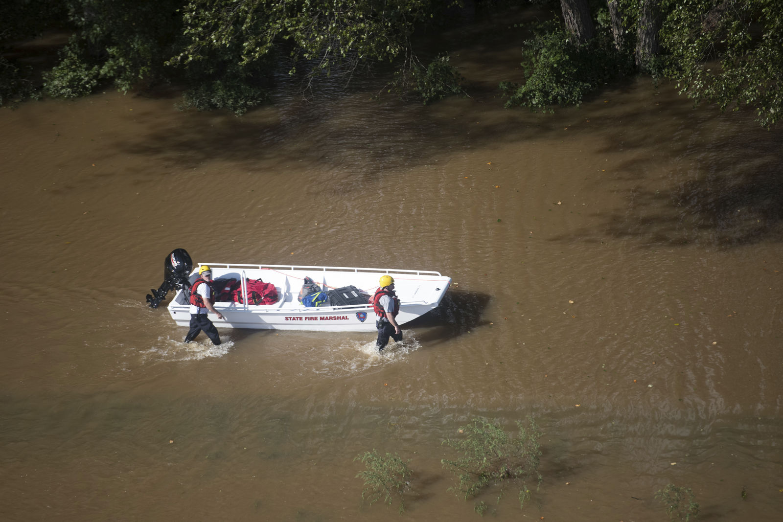 A rescue team pushes a boat towards stranded motorists after Hurricane Florence struck the Carolinas Monday, Sept. 17, 2018, near Wallace, S.C. (AP Photo/Sean Rayford)