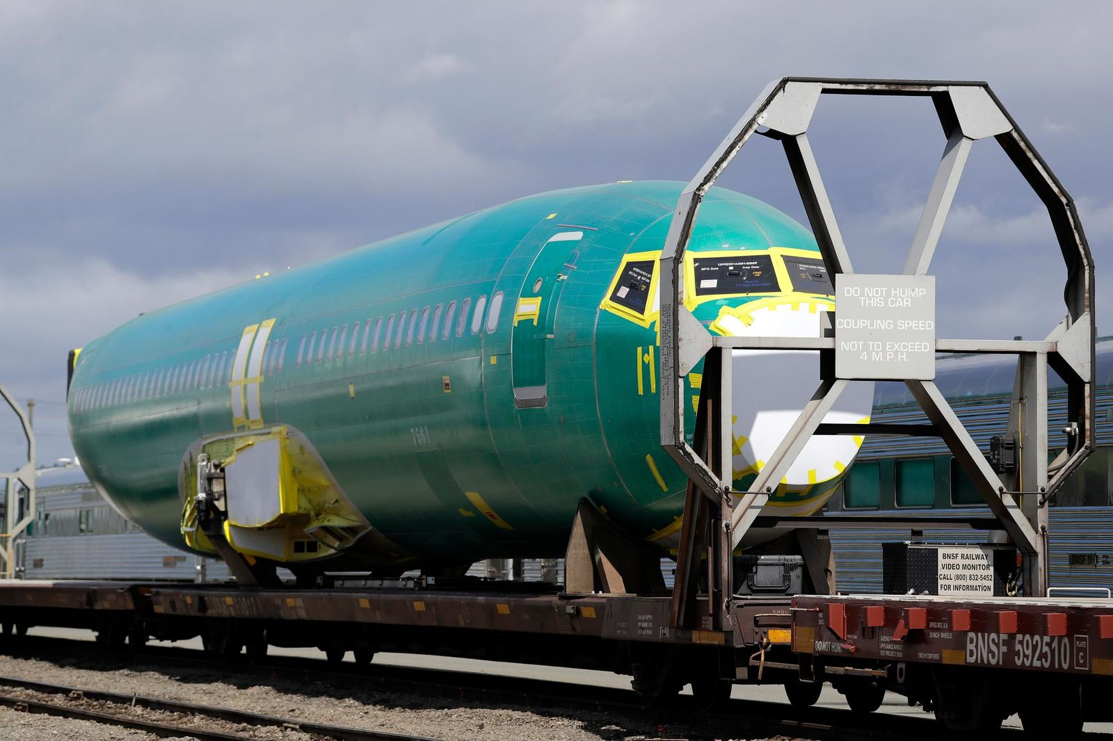 FILE - In this April 9, 2019, file photo a Boeing 737 fuselage, eventually bound for Boeing's production facility in nearby Renton, Wash., sits on a flatcar rail car at a rail yard in Seattle. (AP Photo/Elaine Thompson, File)