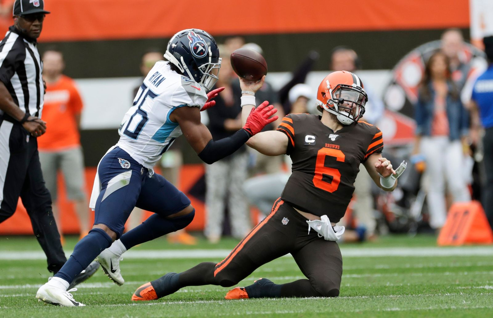 Cleveland Browns quarterback Baker Mayfield (6) throws under pressure from Tennessee Titans cornerback Logan Ryan (26) during the first half in an NFL football game, Sunday, Sept. 8, 2019, in Cleveland. (AP Photo/Ron Schwane)