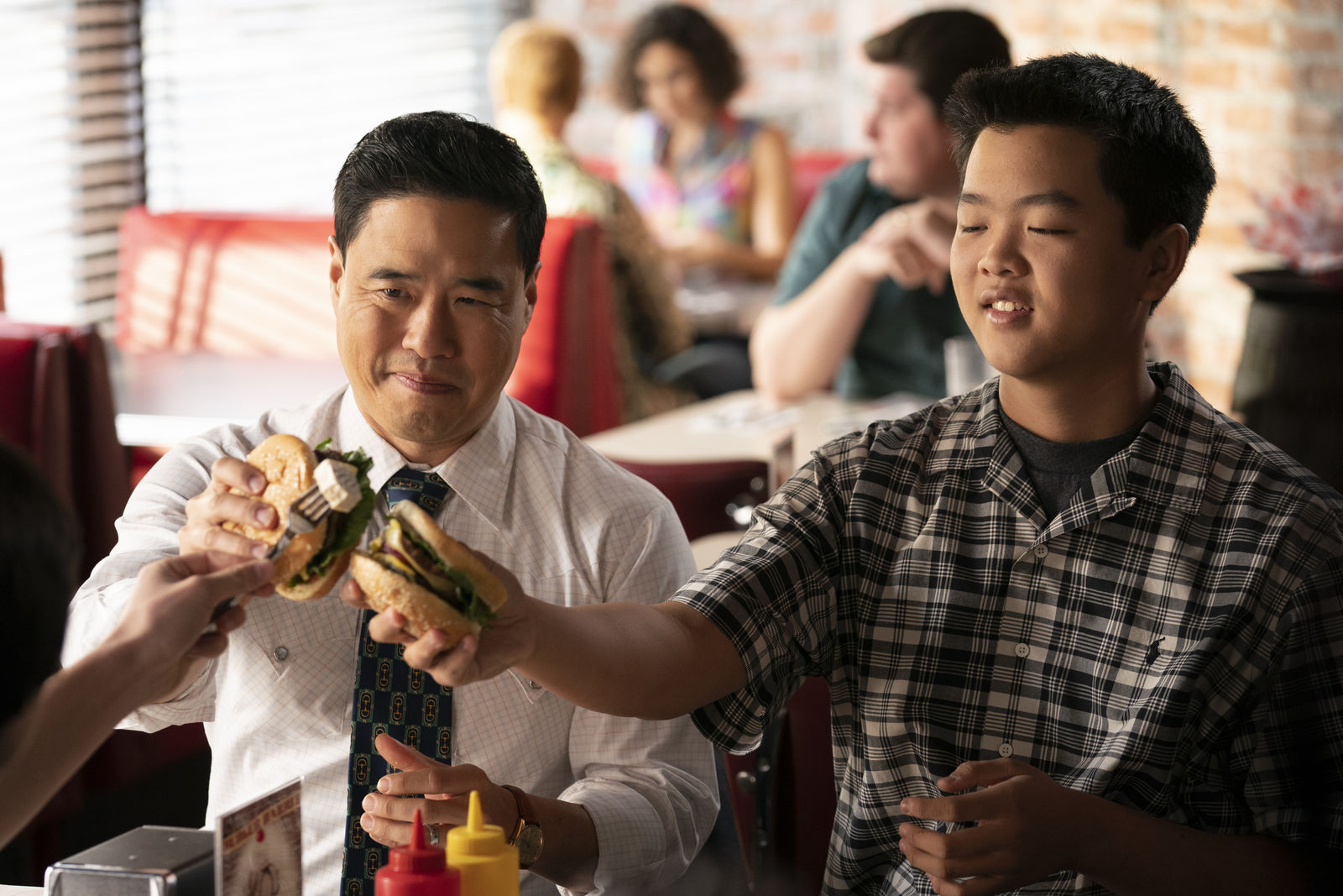 "This undated photo made available by ABC shows Randall Park, left, and Hudson Yang in the Jan. 31, 2020 television episode of ""Fresh Off the Boat."" (Ali Goldstein/ABC via AP)"