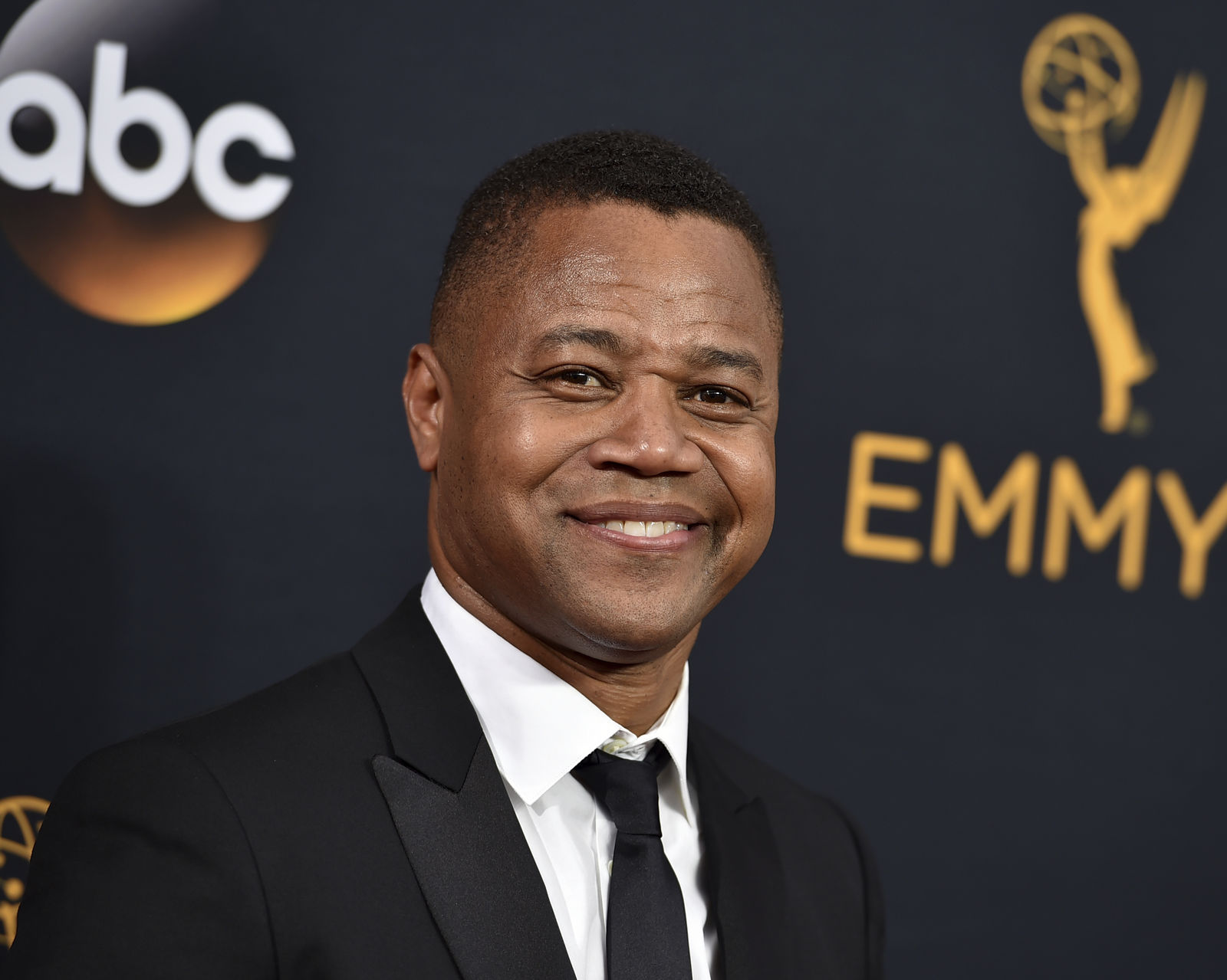 FILE- In this Sept. 18, 2016 file photo, Cuba Gooding Jr. arrives at the 68th Primetime Emmy Awards in Los Angeles. (Photo by Jordan Strauss/Invision/AP, File)