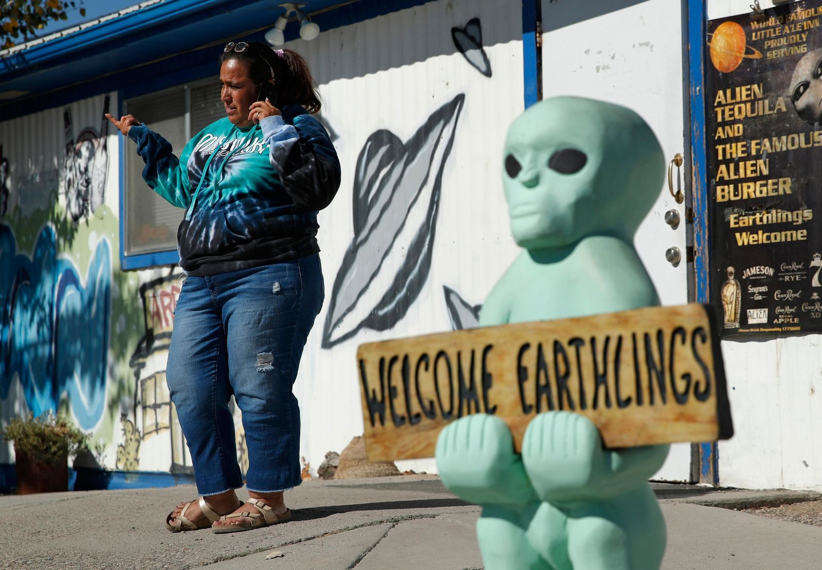 "Little A'Le'Inn owner Connie West speaks on the phone outside of the bar and restaurant, Wednesday, Sept. 18, 2019, in Rachel, Nev. West was preparing for an event spawned from the ""Storm Area 51"" internet hoax. (AP Photo/John Locher)"