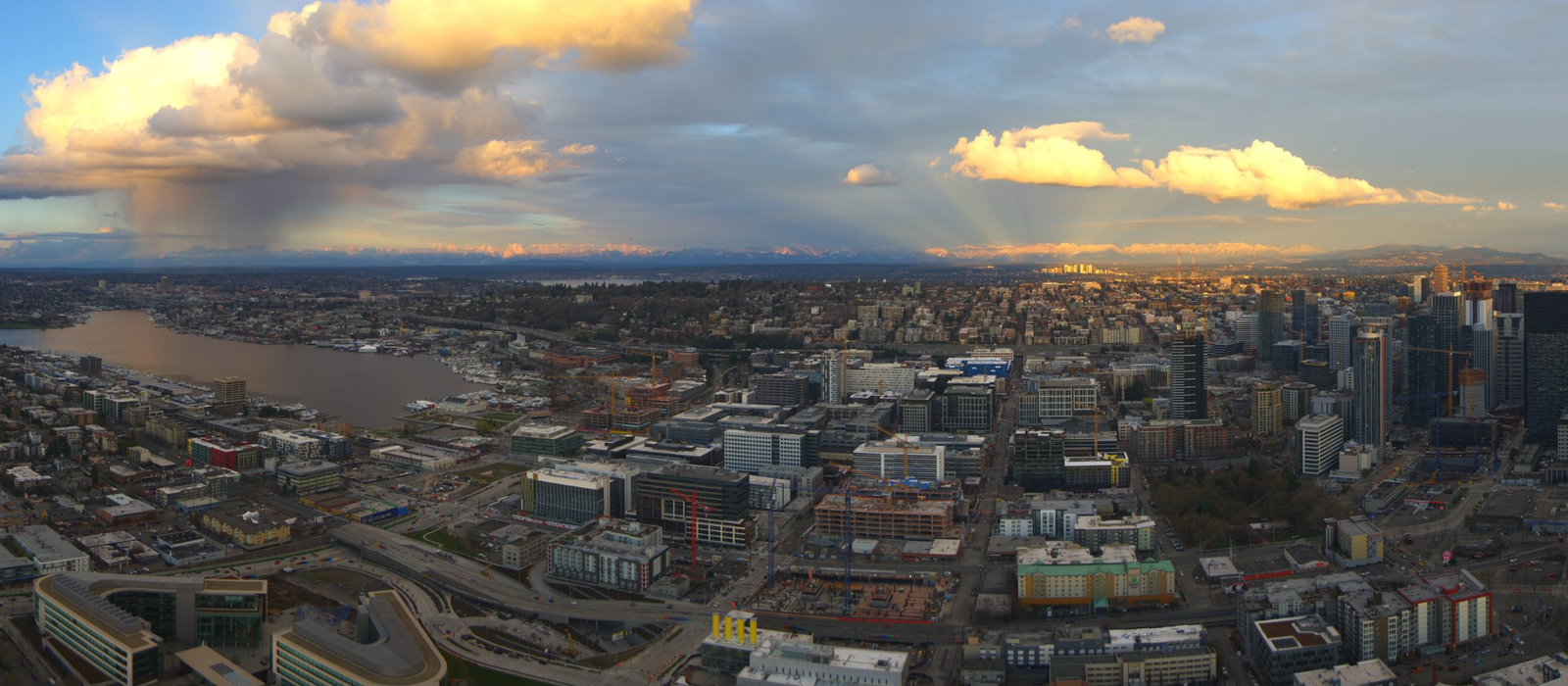 A rain shower falls over North Seattle as anti-crepuscular rays shine behind the city's Skyline on March 24, 2018 (Photo courtesy: Space Needle Web Camera)