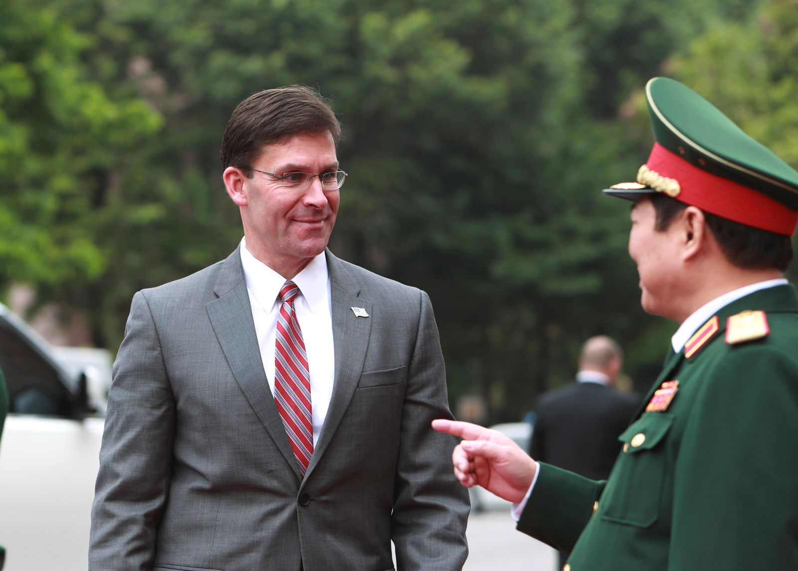 U.S. Defense Secretary Mark Esper, left, and Vietnamese Defense Minister Ngo Xuan Lich talk before a meeting in Hanoi, Vietnam Wednesday, Nov. 20, 2019. (AP Photo/Hau Dinh)