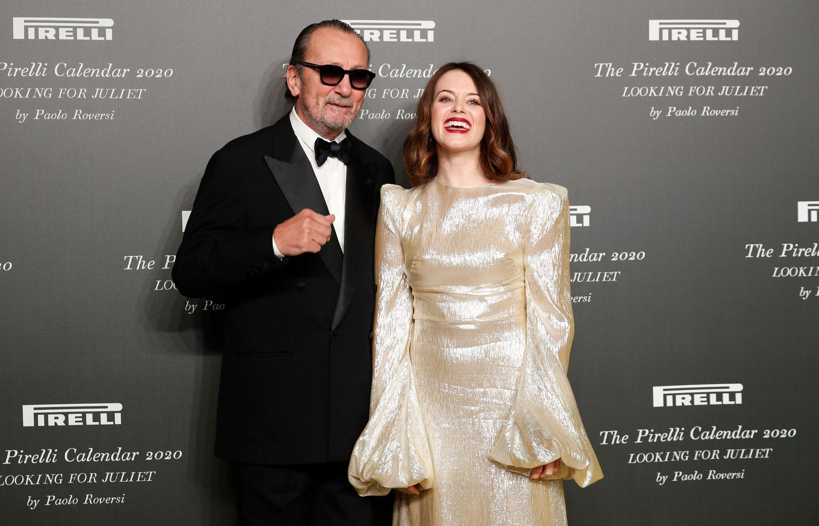 British actress Claire Foy, right, poses with Italian photographer Paolo Roversi, at the 2020 Pirelli Calendar event in Verona, Italy, Tuesday, Dec. 3, 2019. (AP Photo/Antonio Calanni)