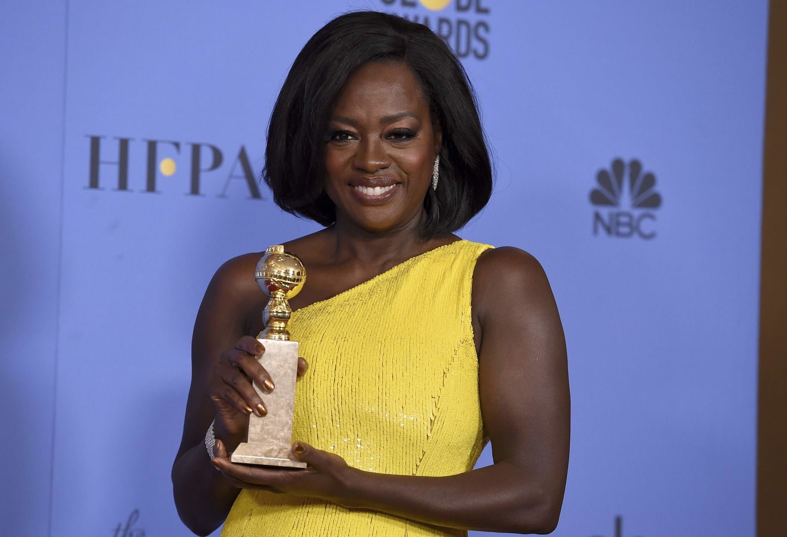 Viola Davis poses in the press room with the award for best performance by an actress in a supporting role in any motion picture for 'Fences' at the 74th annual Golden Globe Awards at the Beverly Hilton Hotel on Sunday, Jan. 8, 2017, in Beverly Hills, Calif. (Photo by Jordan Strauss/Invision/AP)
