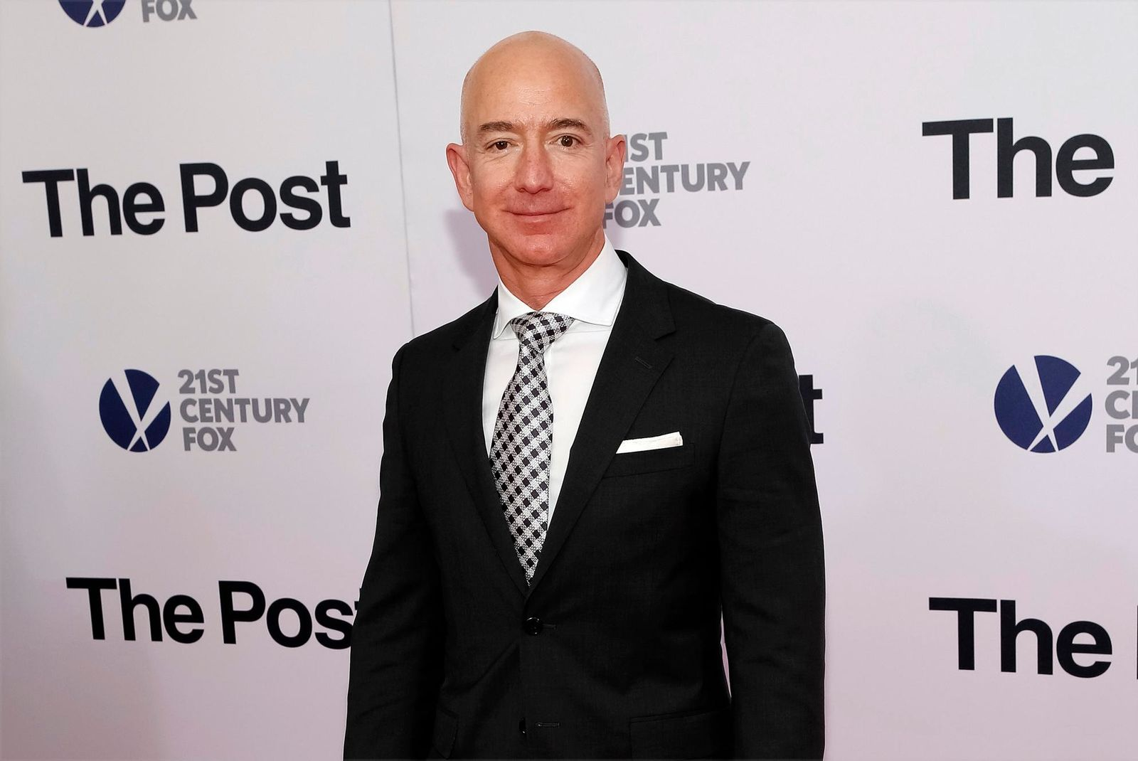 "FILE - In this Dec. 14, 2017, file photo, Jeff Bezos attends the premiere of ""The Post"" at The Newseum in Washington. (Photo by Brent N. Clarke/Invision/AP, File)"
