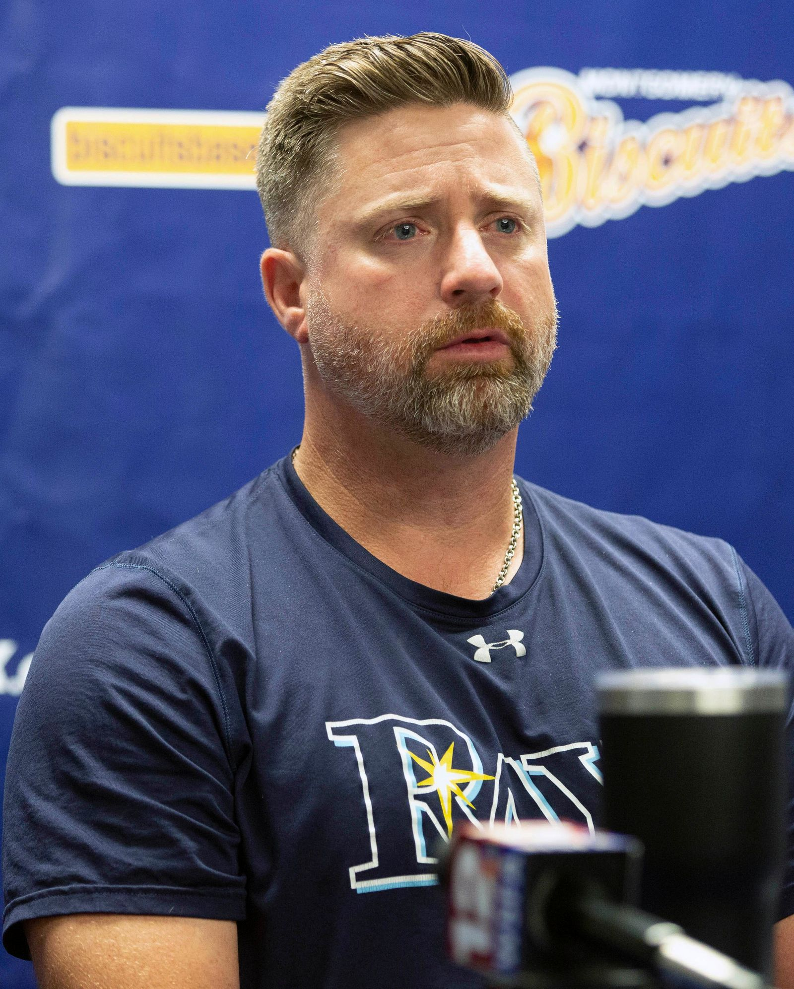 Montgomery Biscuits manager Morgan Ensberg, with tears in his eyes, talks about Blake Bivens, a pitcher with the team whose wife and child were killed in a triple homicide Thursday, Aug. 29, 2019 in Montgomery, Ala. (Kirsten Fiscus/Montgomery Advertiser via AP)