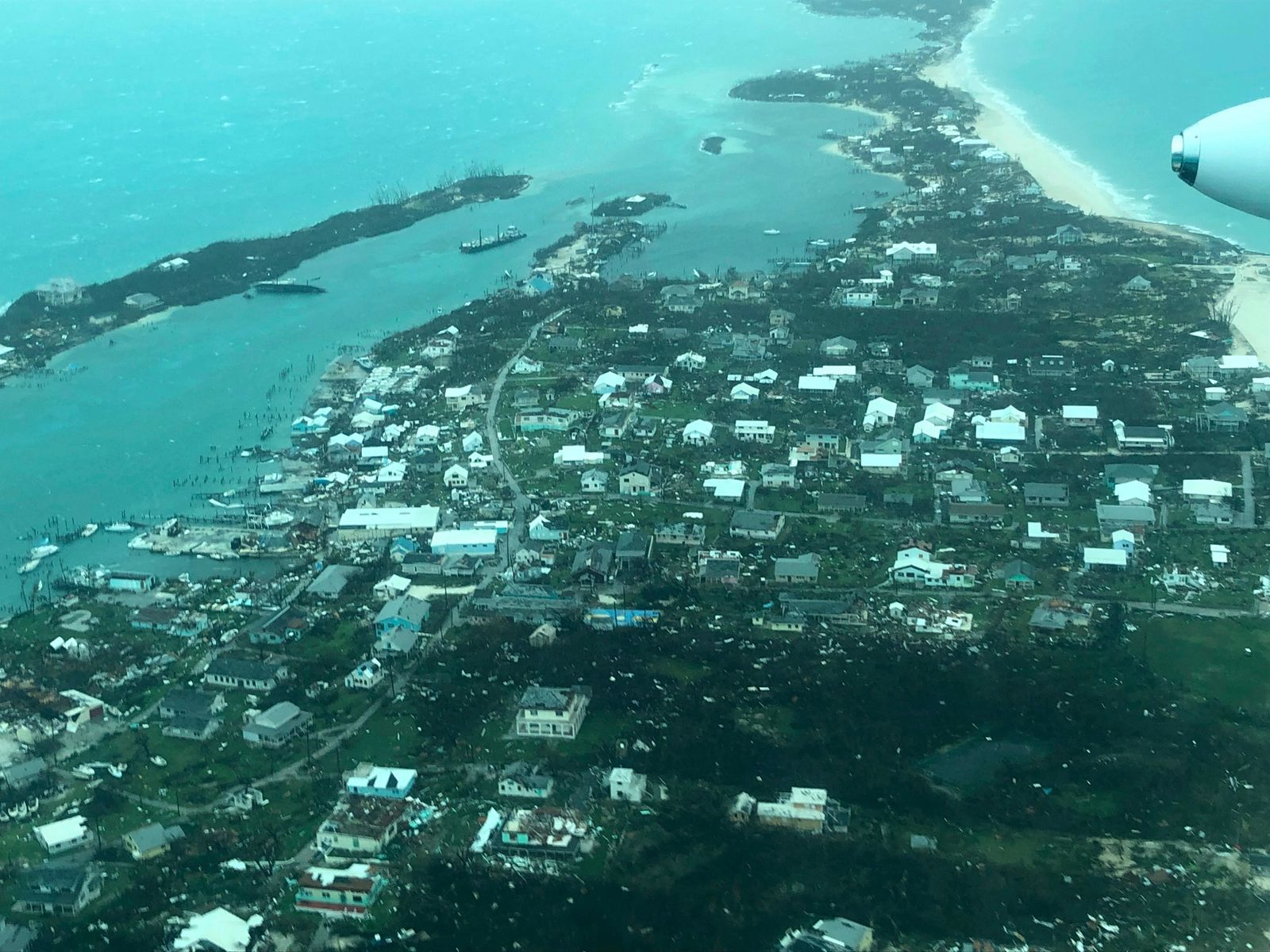 This aerial photo provided by Medic Corps, shows the destruction brought by Hurricane Dorian on Man-o-War Cay, Bahamas, Tuesday, Sept.3, 2019. (Medic Corps via AP)