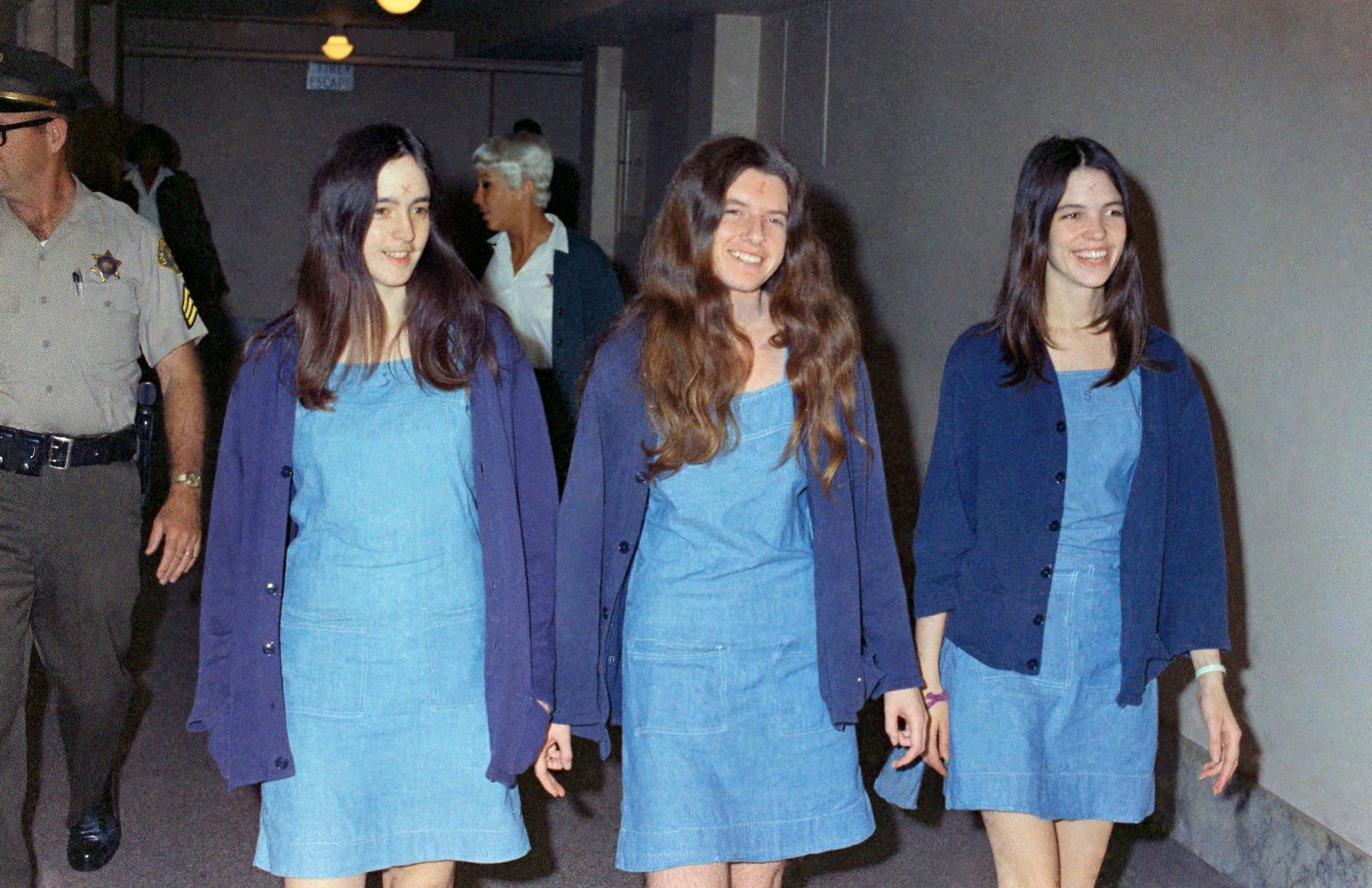 FILE - In this Aug. 20, 1970, file photo, Charles Manson followers, from left, Susan Atkins, Patricia Krenwinkel and Leslie Van Houten walk to court to appear for their roles in the 1969 cult killings of seven people in Los Angeles. (AP Photo/George Brich, File)