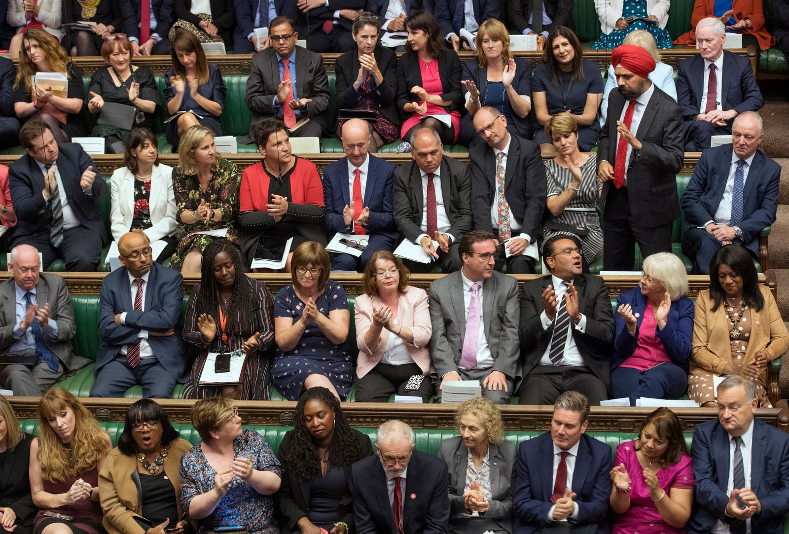 In this handout photo provided by the House of Commons, Labour MP Tanmanjeet Singh Dhesi, standing, speaks during Boris Johnson's first Prime Minister's Questions, in the House of Commons in London, Wednesday, Sept. 4, 2019.(Jessica Taylor/House of Commons via AP)