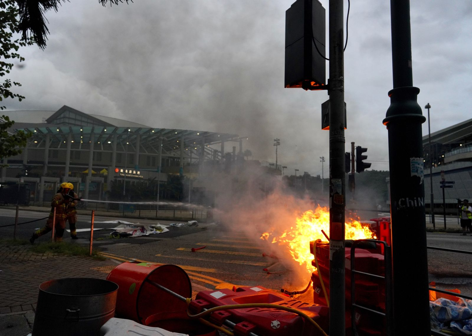 Firemen try to douse fire after protesters set fire to barricades and vandalized signages at Tung Chung near airport in Hong Kong, Sunday, Sept.1, 2019.{ } (AP Photo/Vincent Yu)