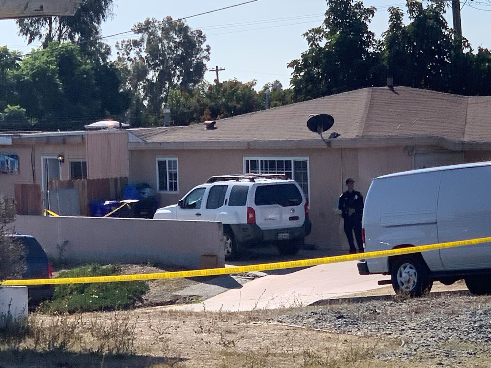 San Diego police investigate a shooting that killed five members of a family and wounded one more in Paradise Hills on Saturday, Nov. 16, 2019 in San Diego, Calif. Police said two adults and three children were shot to death and a fourth child was hospitalized with injuries in an apparent murder-suicide in San Diego. (Hayne Palmour/The San Diego Union-Tribune via AP)