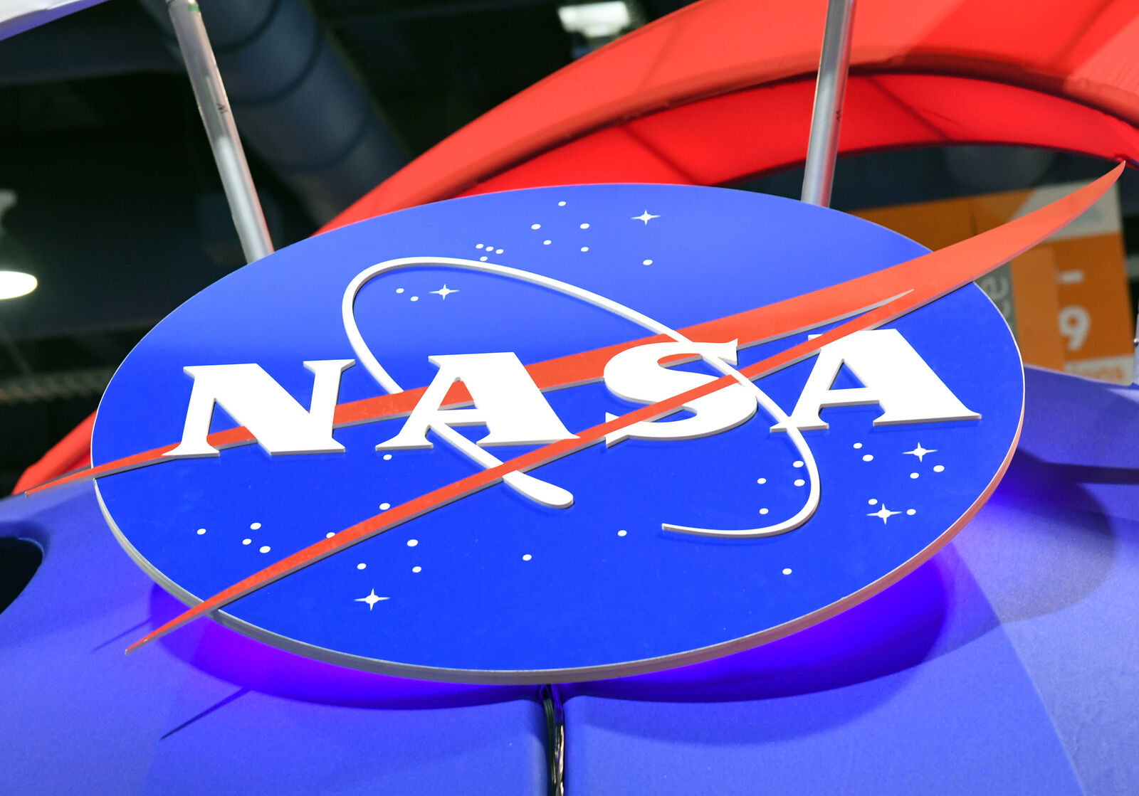 FILE – The NASA logo is displayed at the agency's booth during CES 2018 at the Las Vegas Convention Center on January 11, 2018 in Las Vegas, Nevada. (Photo by Ethan Miller/Getty Images)