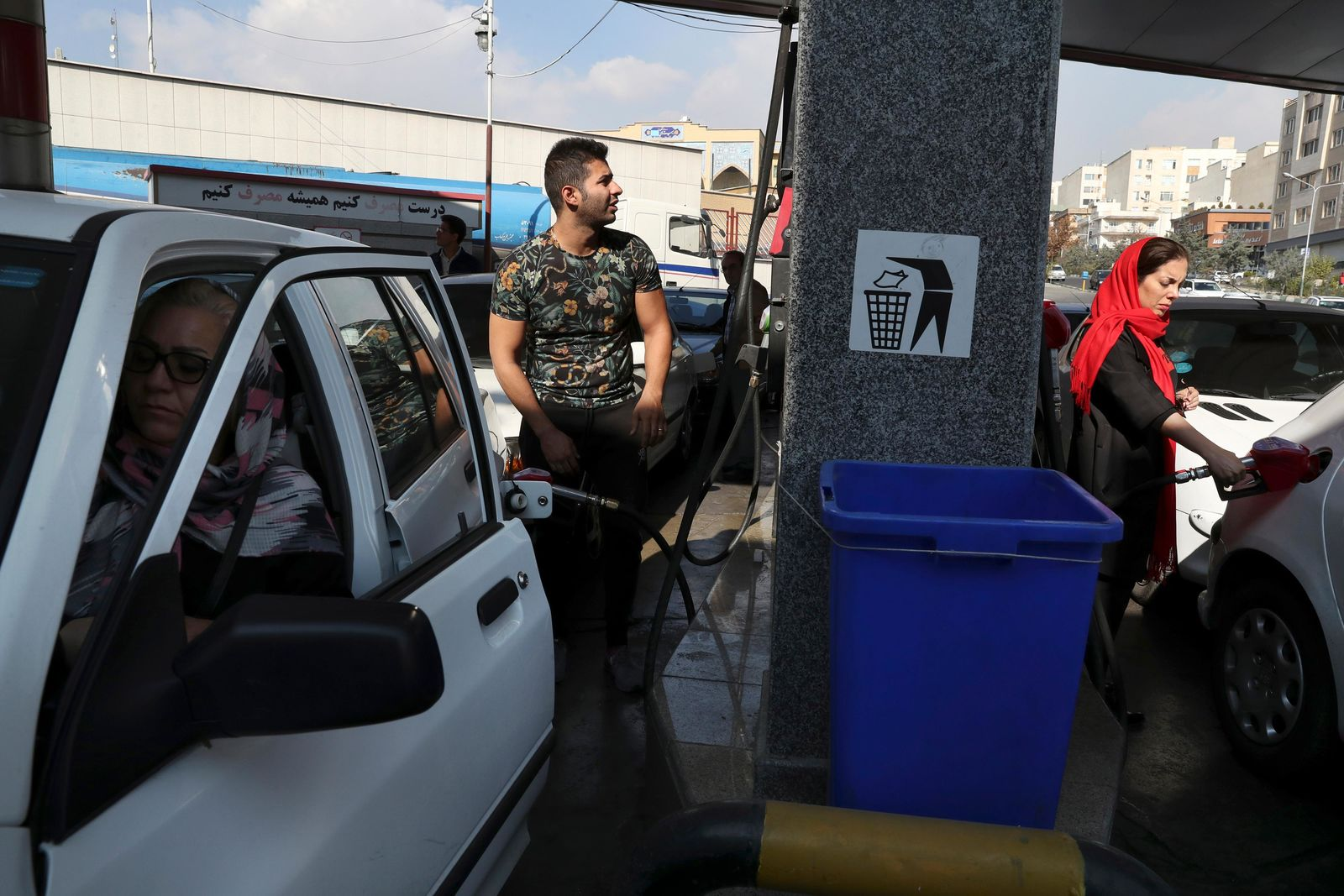 People fill their cars at a gas station in Tehran, Iran, Friday, Nov. 15, 2019. Authorities have imposed rationing and increased the prices of fuel.{ } (AP Photo/Vahid Salemi)