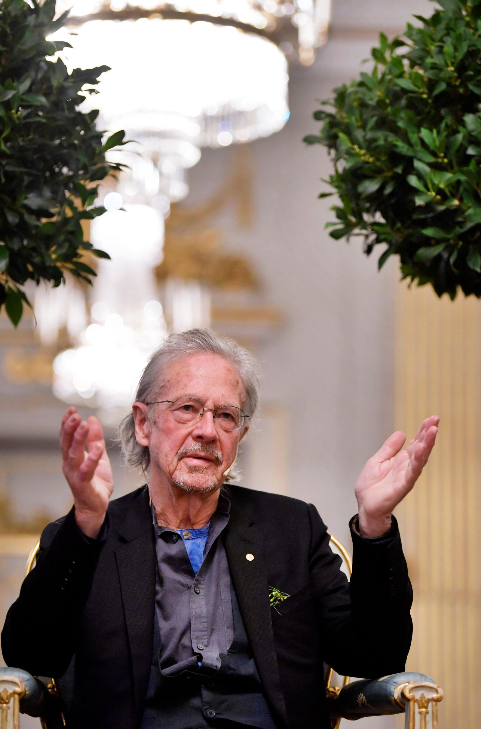 2019 Nobel Prize laureate in literature Peter Handke speaks at a press conference at the Swedish Academy in Stockholm, Sweden, Monday Dec. 6, 2019. (Anders Wiklund/TT via AP)
