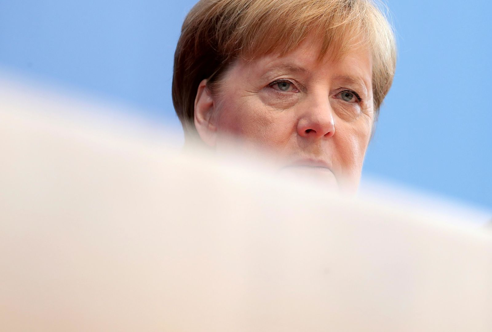 German Chancellor Angela Merkel attends her annual sommer press conference in Berlin, Germany, Friday, July 19, 2019. (AP Photo/Michael Sohn)