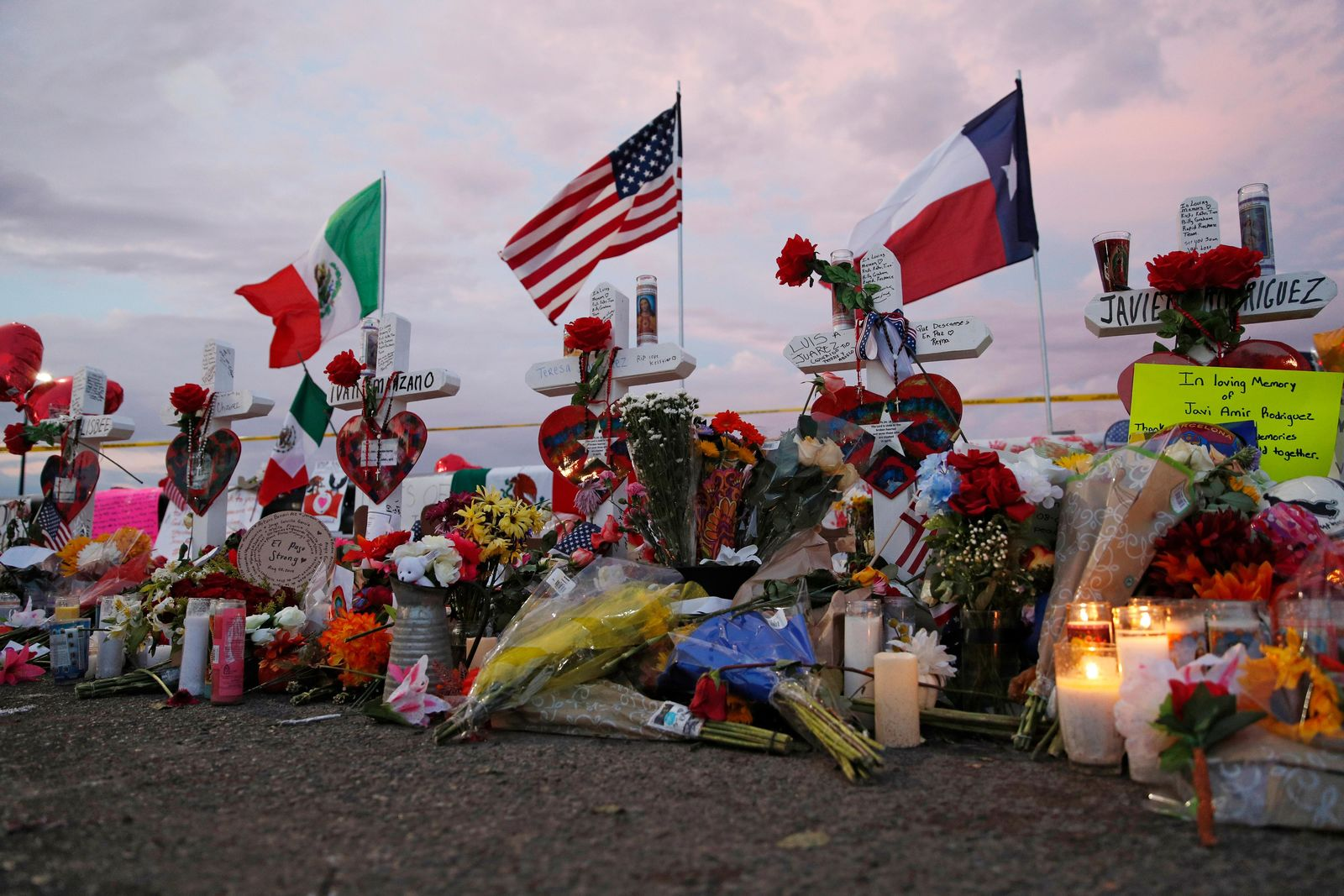Flags fly over crosses at a makeshift memorial near the scene of a mass shooting at a shopping complex Tuesday, Aug. 6, 2019, in El Paso, Texas. (AP Photo/John Locher)