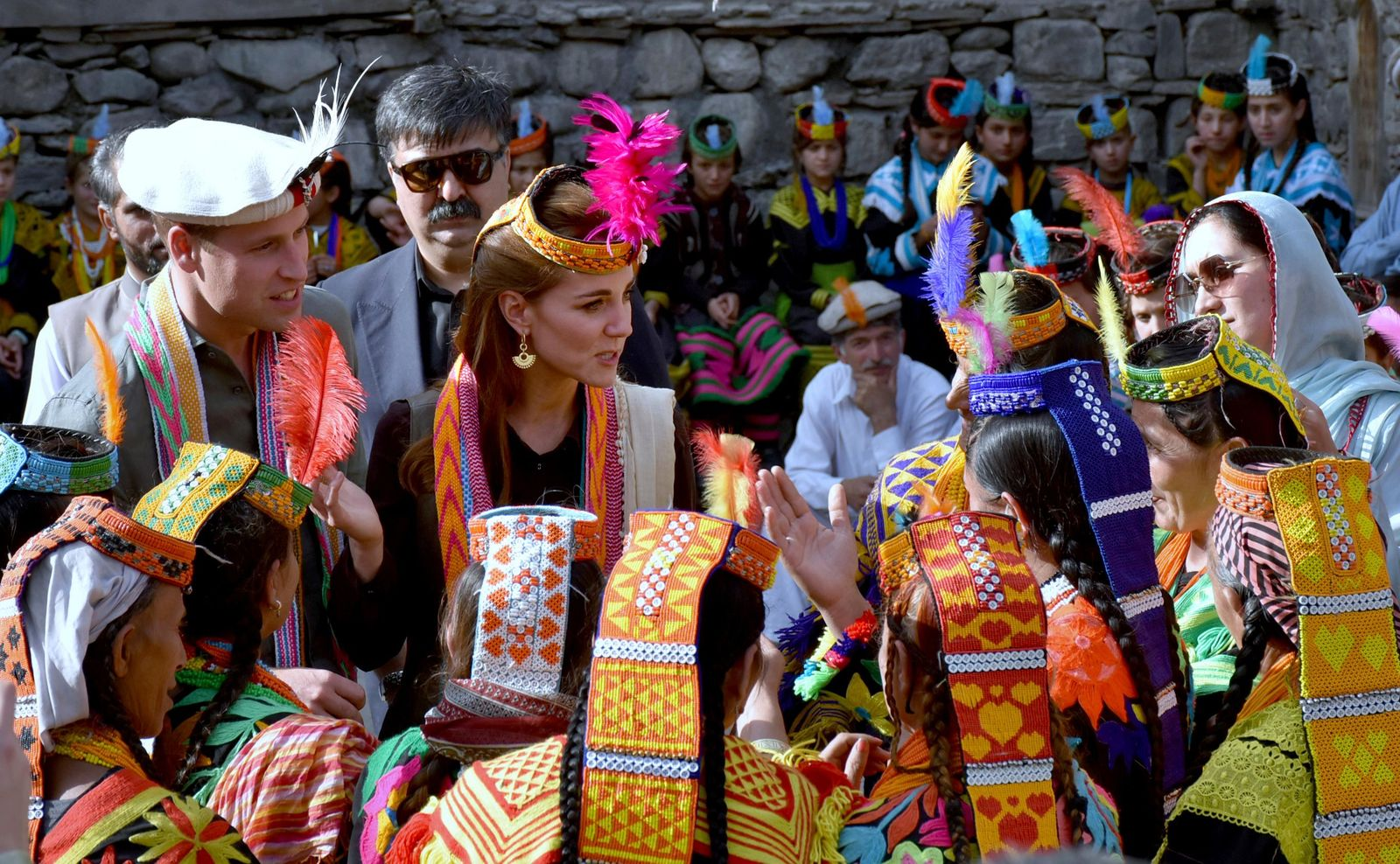 In this photo released by Press Information Department, Britain's Prince William, left, and his wife Kate chat with women of Kalash community during their visit to Bumburate Valley, an area of Pakistan's northern Chitral district, Wednesday Oct. 16, 2019. (Press Information Department via AP)