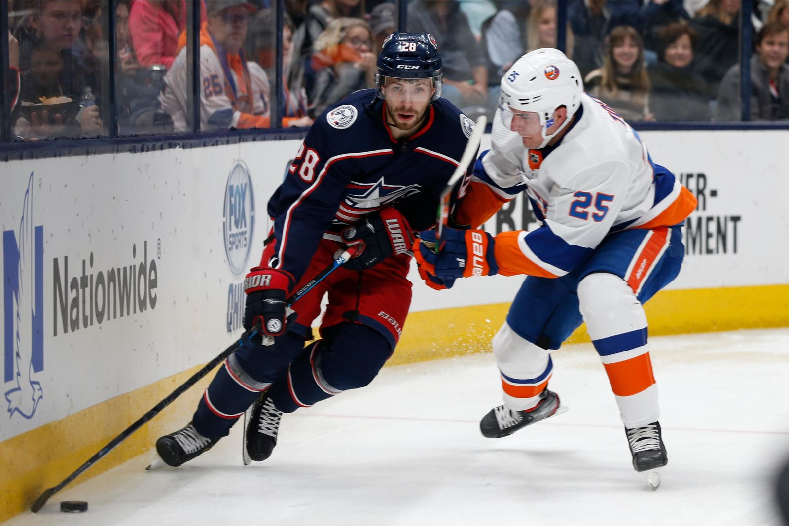 Columbus Blue Jackets' Oliver Bjorkstrand, left, of Denmark, looks for an open pass as New York Islanders' Devon Toews defends during the second period of an NHL hockey game Saturday, Oct. 19, 2019, in Columbus, Ohio. (AP Photo/Jay LaPrete)