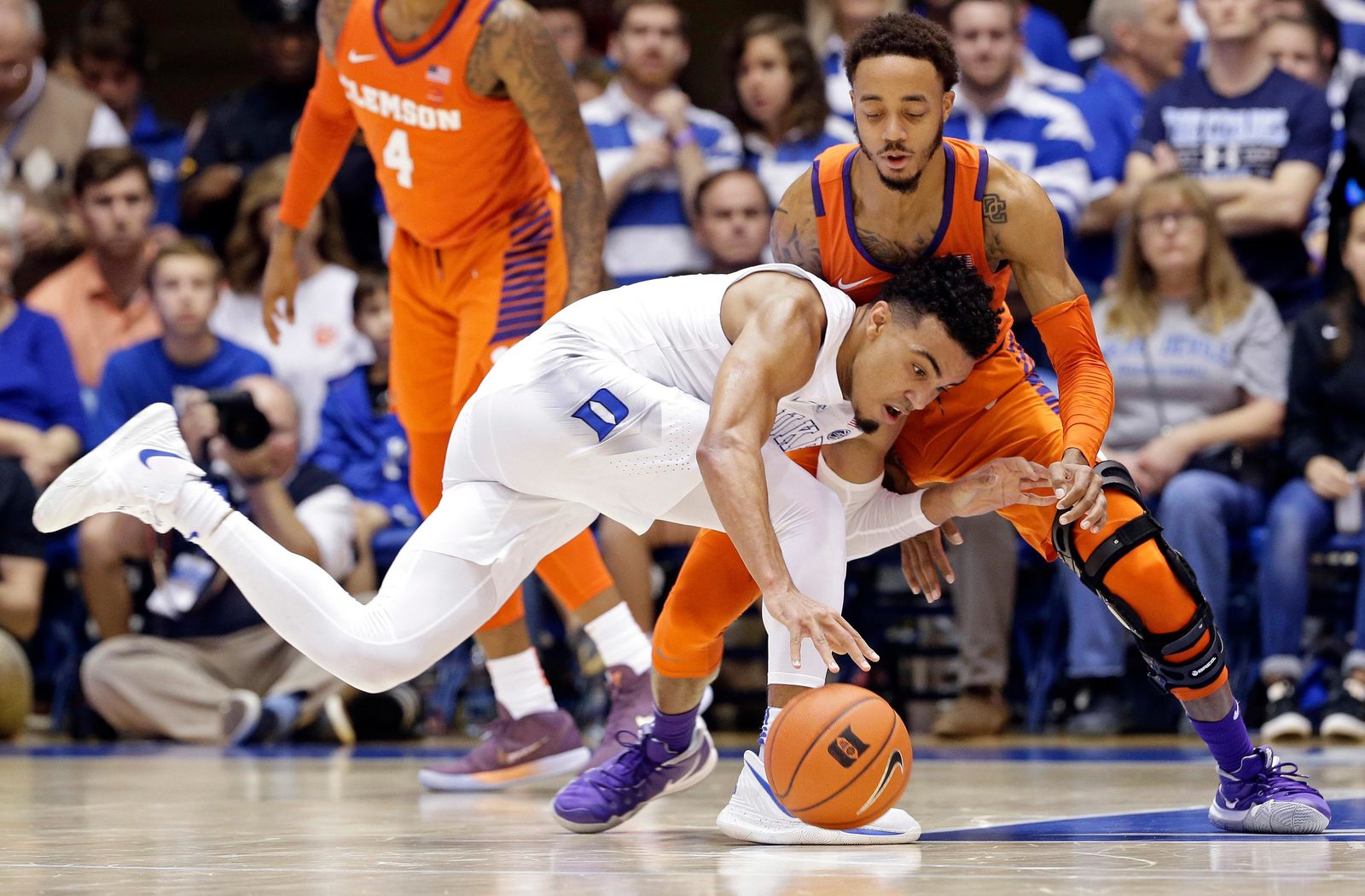 Duke's Tre Jones dribbles the ball while Clemson's Marcquise Reed defends during the first half of an NCAA college basketball game in Durham, N.C., Saturday, Jan. 5, 2019. (AP Photo/Gerry Broome)