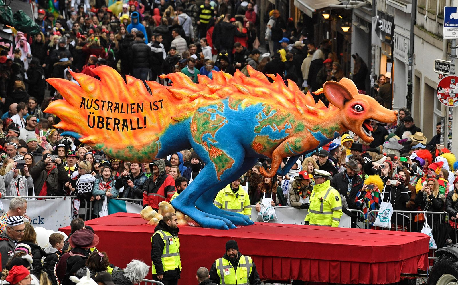 A carnival float depicts a burning kangaroo, reading 'Australia is everywhere' during the traditional carnival parade in Duesseldorf, Germany, on Monday, Feb. 24, 2020. The foolish street spectacles in the carnival centers of Duesseldorf, Mainz and Cologne, watched by hundreds of thousands of people, are the highlights in Germany's carnival season on Rosemonday. (AP Photo/Martin Meissner)