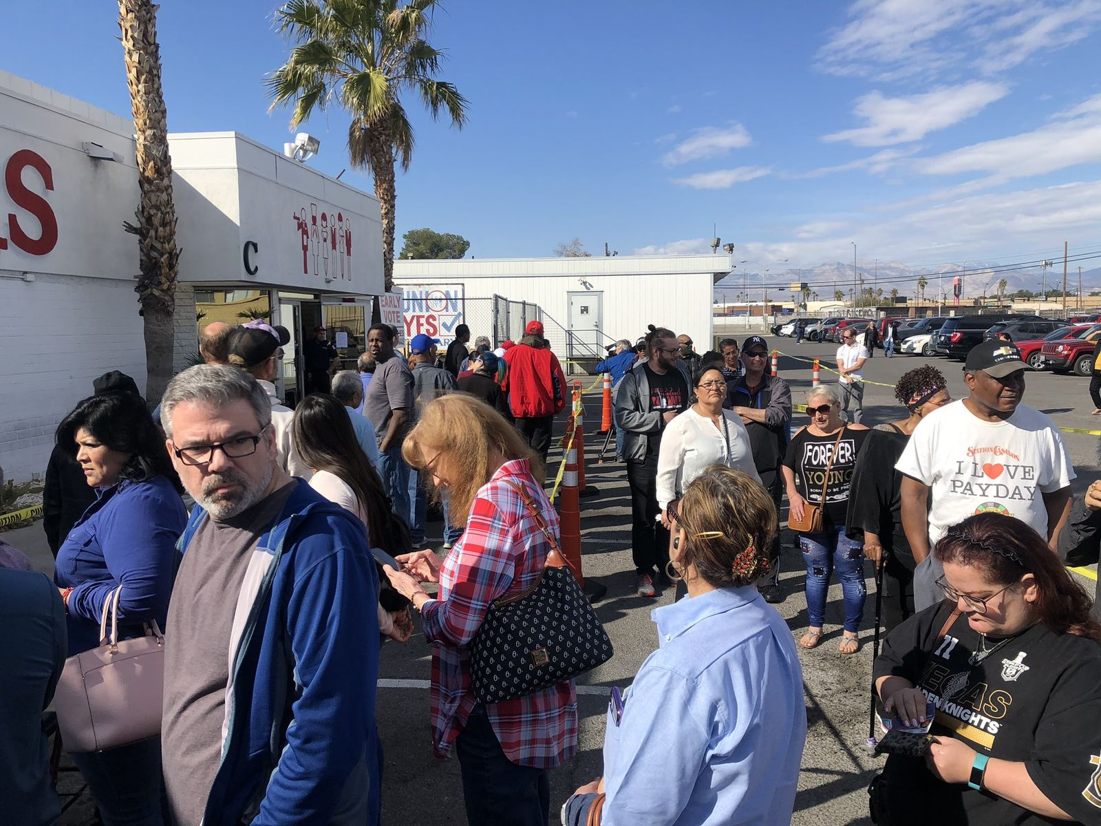 People line up for early caucus voting in Las Vegas on Monday, Feb. 17, 2020. (Faith Jessie | KSNV)