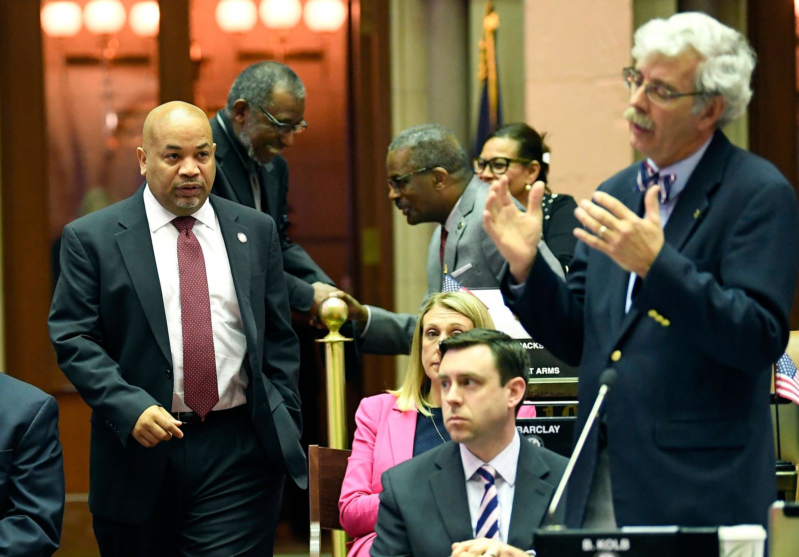 Assembly Speaker Carl Heastie, D-Bronx, left, walks on the Assembly floor as Assemblyman Andy Goodell, R-Jamestown ,right, speaks to members of the New York state Assembly against legislation that authorizes state tax officials to release, if requested, individual New York state tax returns to Congress during a vote in the Assembly Chamber at the state Capitol Wednesday, May 22, 2019, in Albany, N.Y. (AP Photo/Hans Pennink)