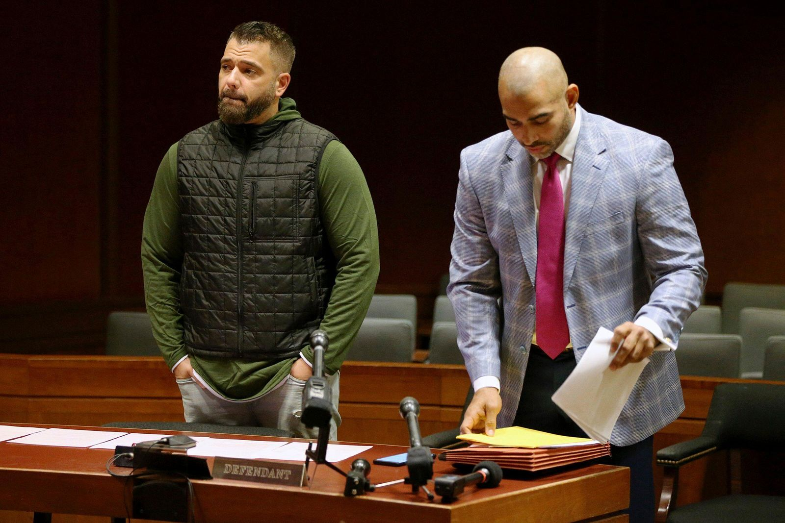 Mark D'Amico, left, stands with his lawyer, Mark Davis, as he prepares to plead guilty to one count of misappropriating entrusted funds in Burlington County Superior Court in Mount Holly, N.J., on Friday, Dec. 6, 2019. (Tim Tai/The Philadelphia Inquirer via AP)